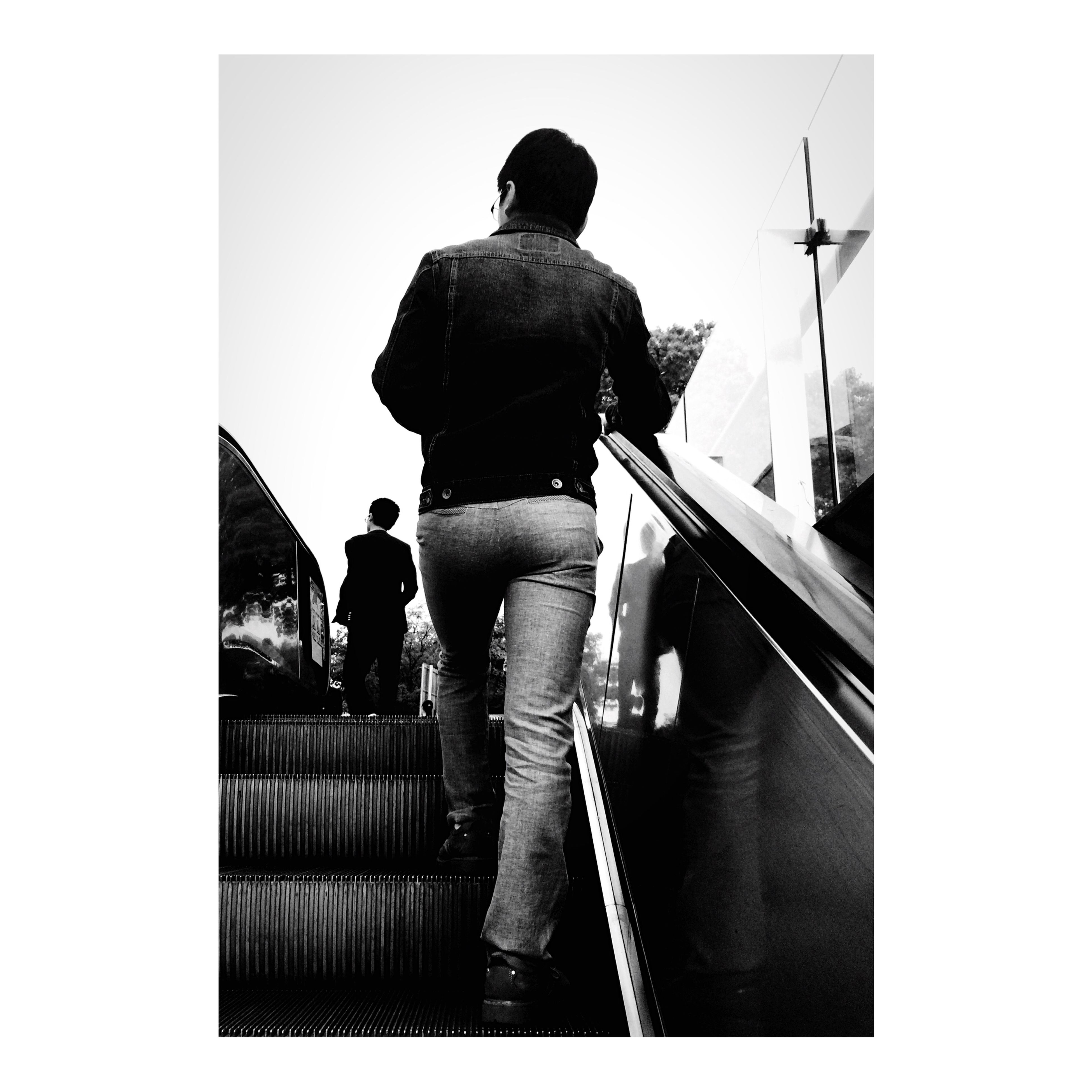 men, transfer print, lifestyles, rear view, full length, railing, person, standing, auto post production filter, leisure activity, togetherness, walking, silhouette, built structure, architecture, day