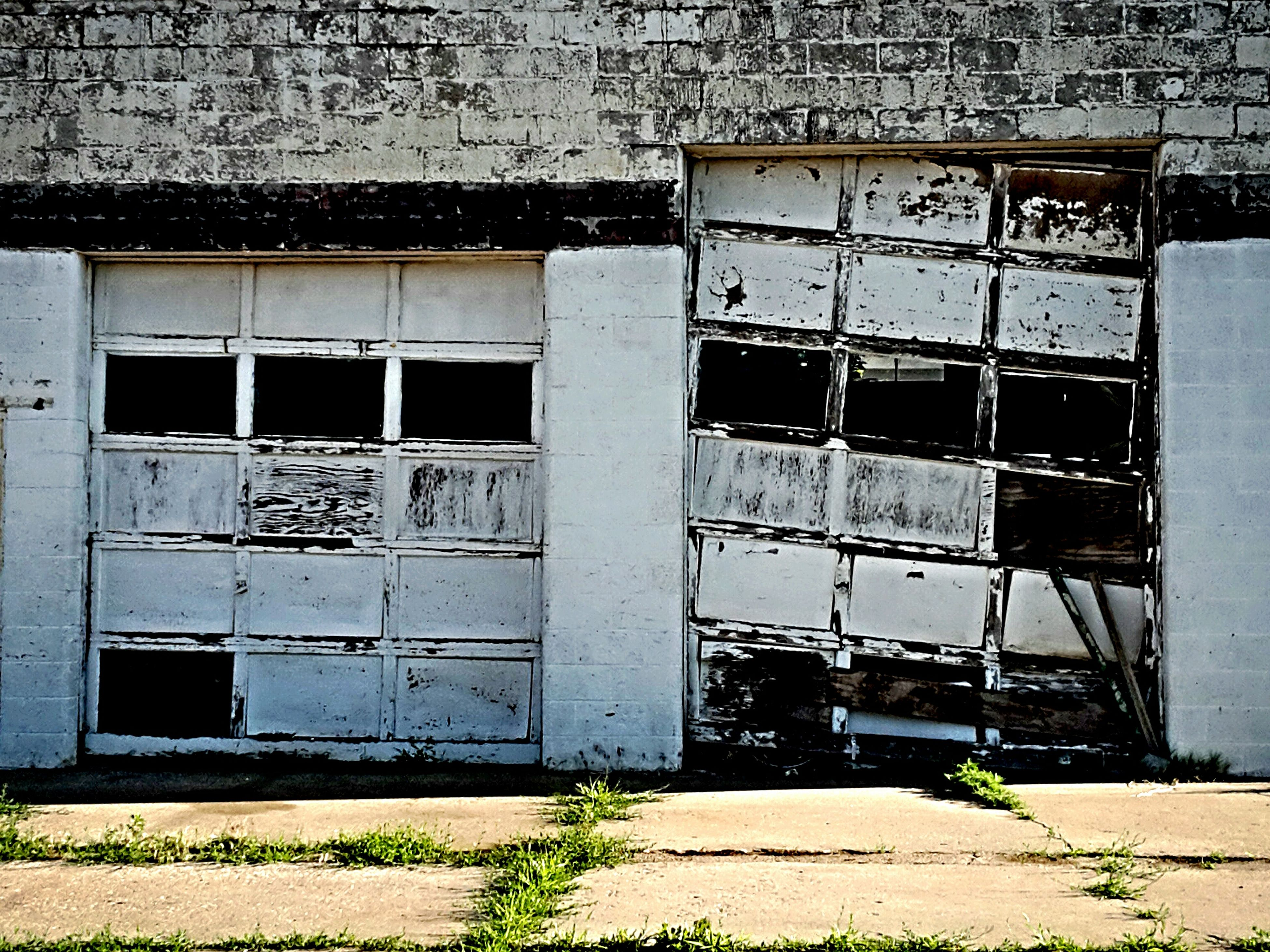 architecture, built structure, building exterior, abandoned, old, obsolete, graffiti, damaged, window, run-down, weathered, deterioration, house, building, wall - building feature, day, door, outdoors, closed, no people