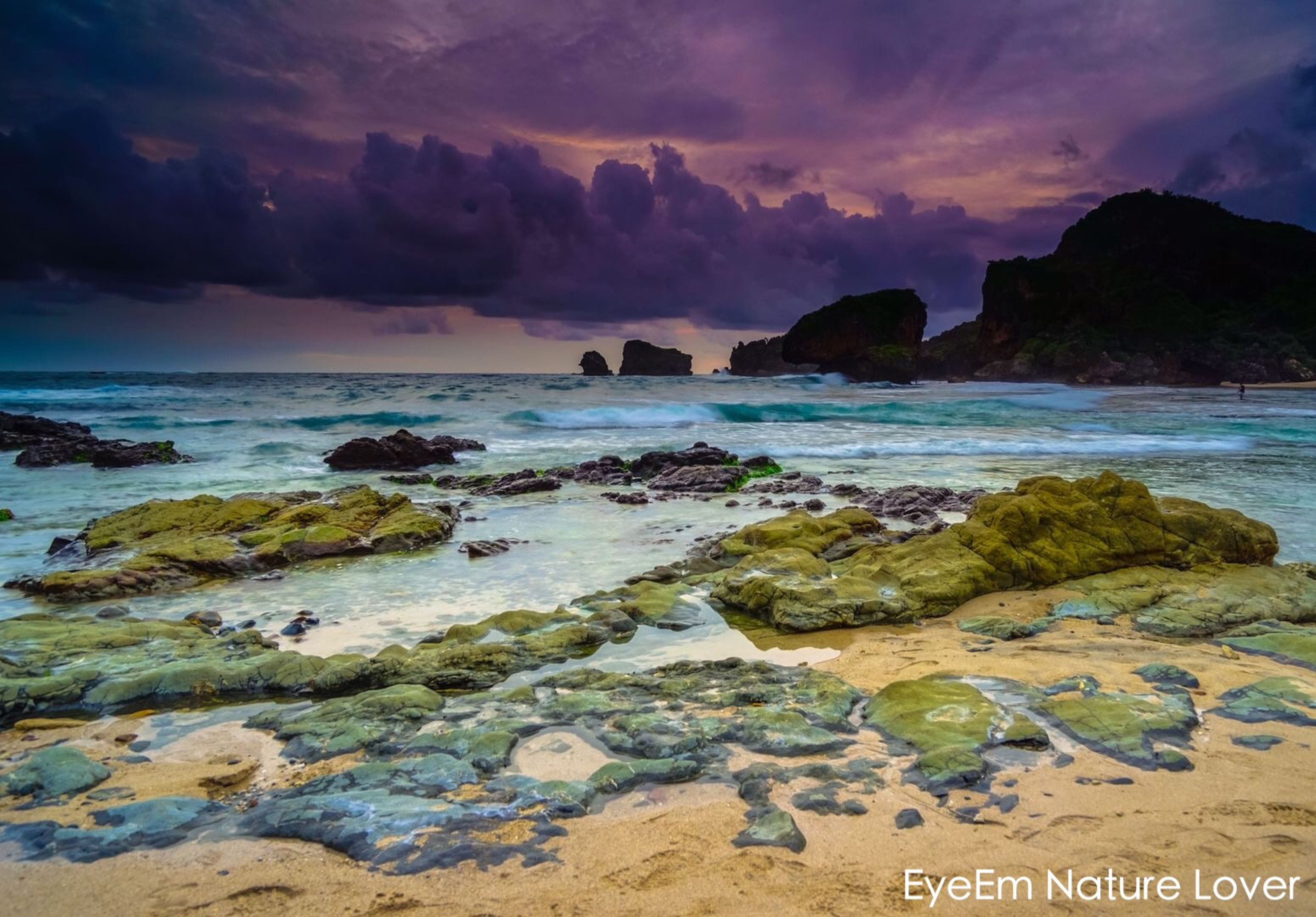 water, sea, sky, scenics, tranquil scene, beauty in nature, tranquility, rock - object, beach, cloud - sky, shore, sunset, nature, horizon over water, rock formation, idyllic, mountain, coastline, cloud, cloudy