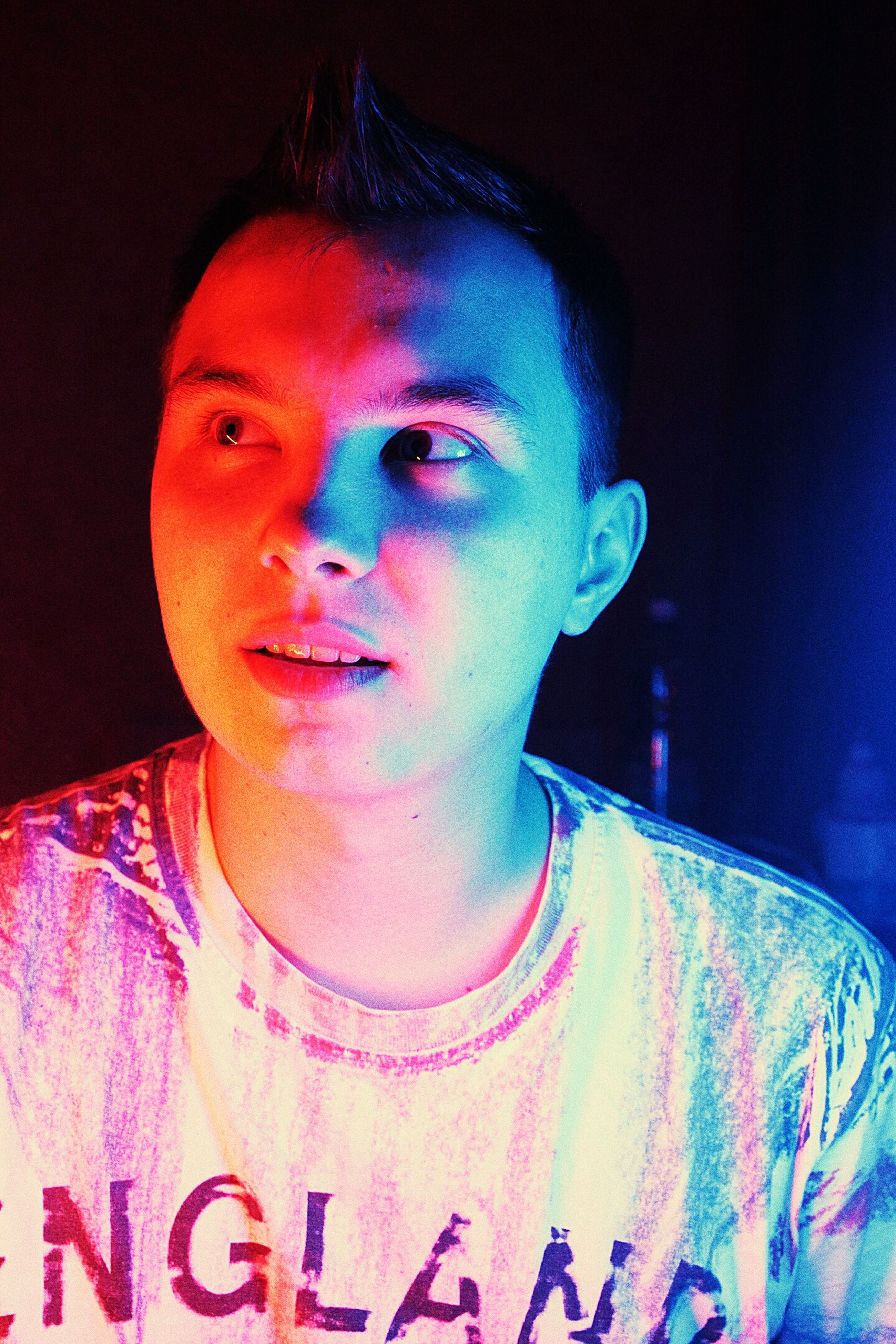 lifestyles, front view, multi colored, looking at camera, portrait, one person, neon, real people, illuminated, night, young adult, indoors, only women, neon colored, people, adult