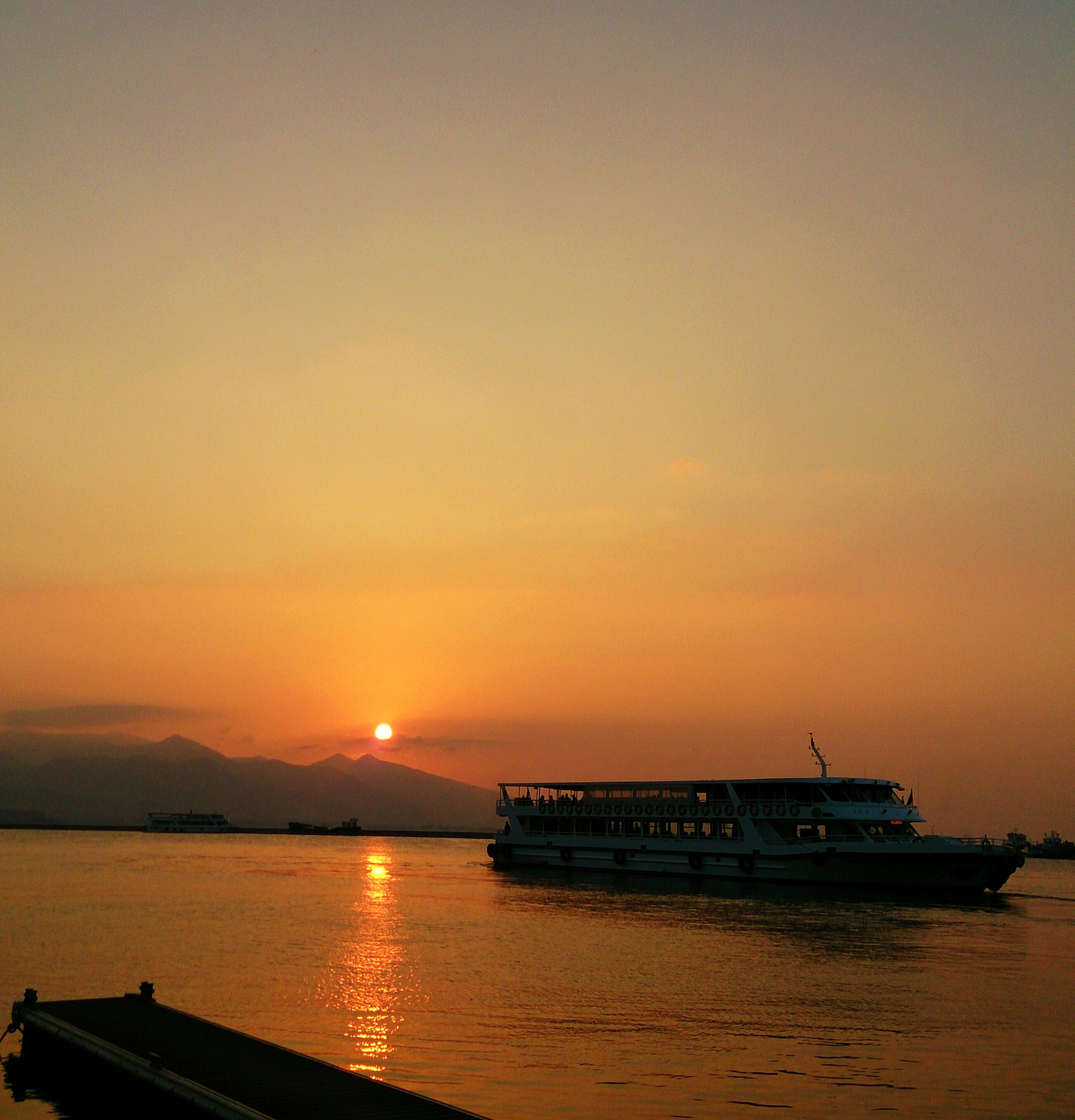 sunset, nautical vessel, transportation, water, mode of transport, boat, orange color, sea, sun, scenics, beauty in nature, waterfront, tranquil scene, sky, moored, tranquility, silhouette, nature, reflection, idyllic
