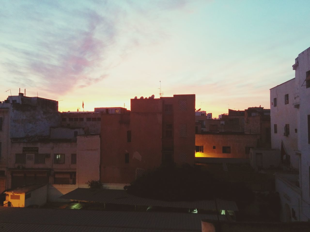 architecture, building exterior, sunset, built structure, sky, no people, city, cityscape, outdoors, day
