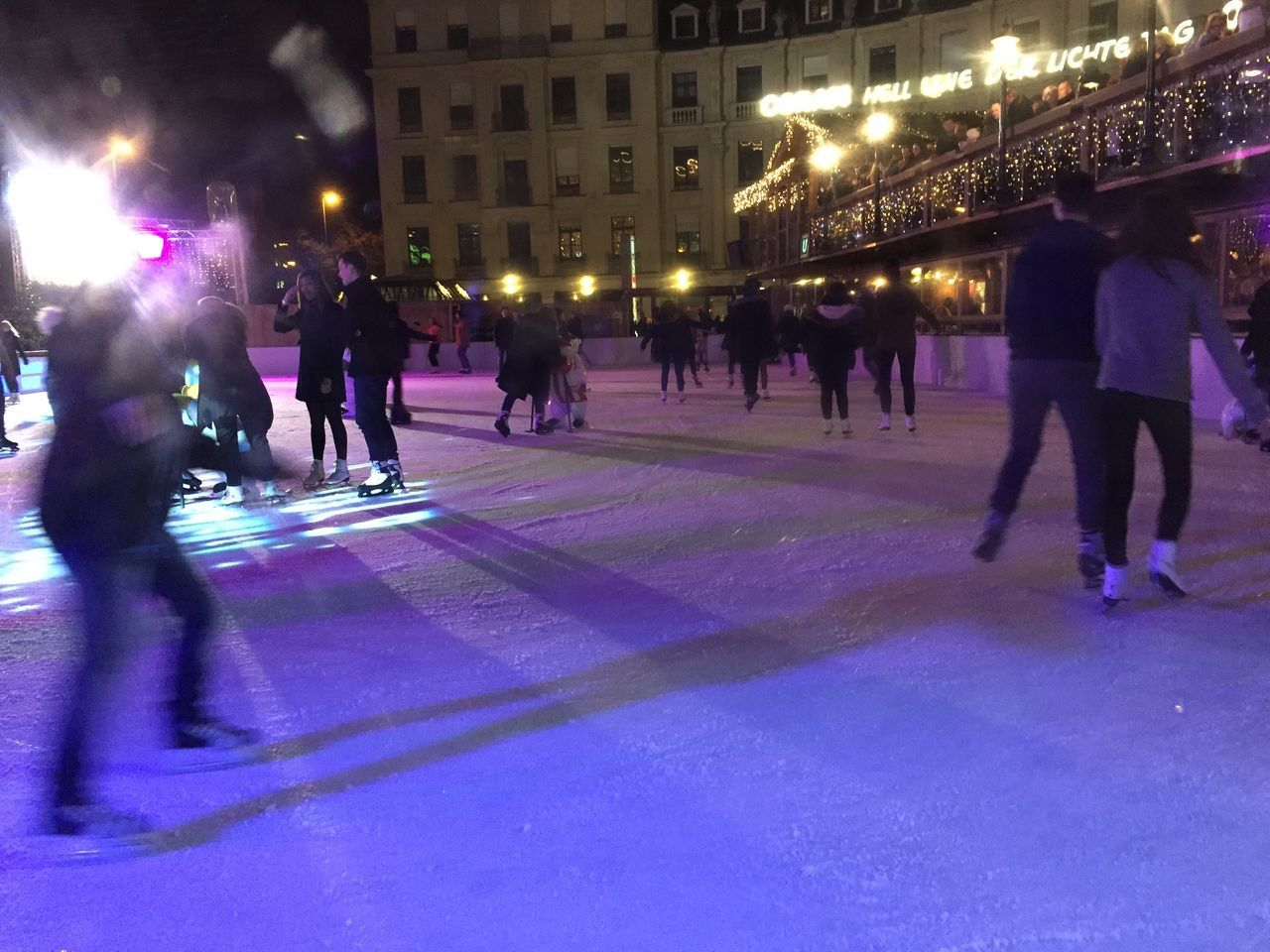 large group of people, built structure, architecture, real people, building exterior, illuminated, men, leisure activity, night, women, lifestyles, city, city life, outdoors, crowd, ice rink, adult, people