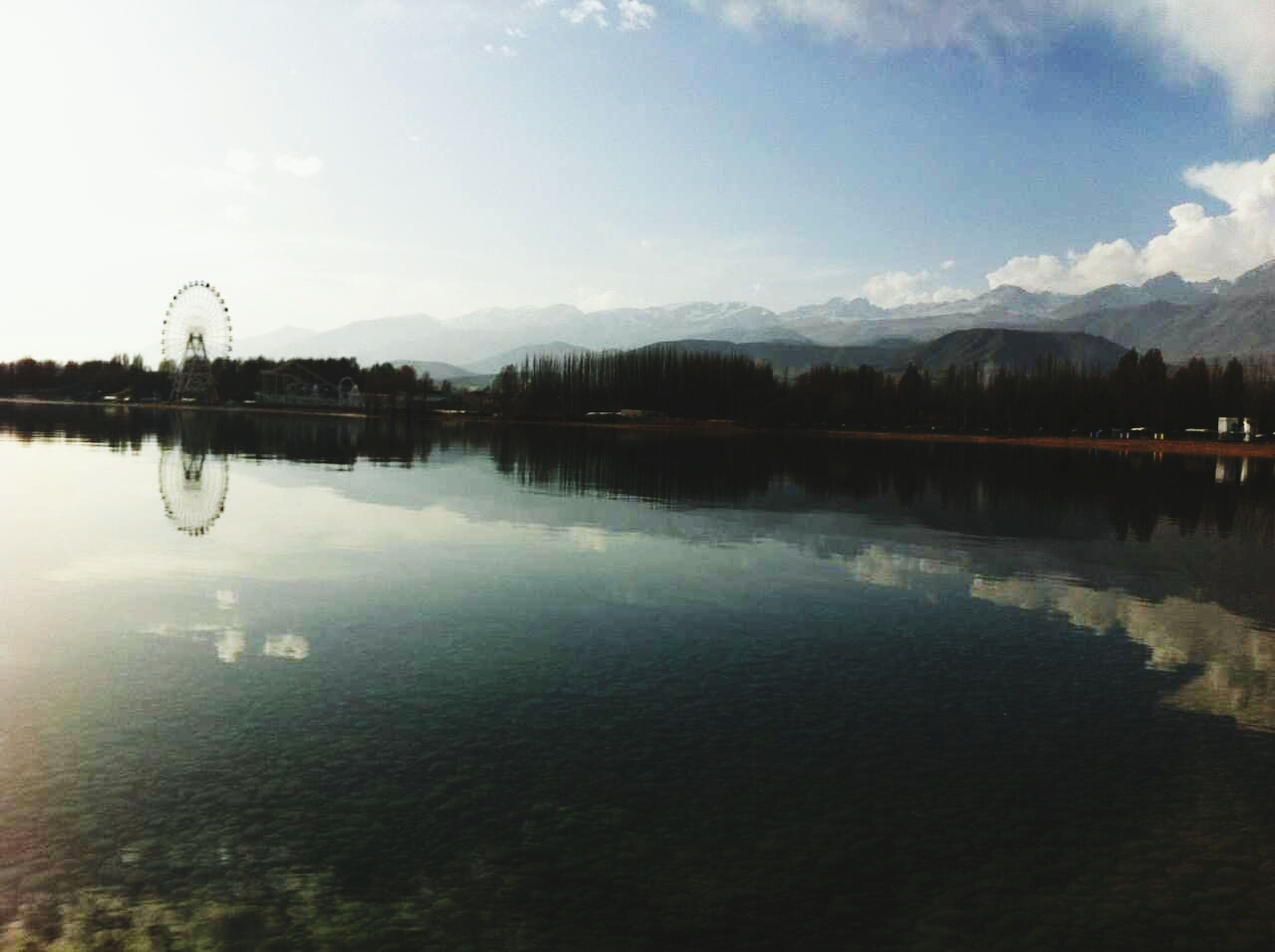 reflection, water, lake, sky, tranquil scene, tranquility, waterfront, scenics, beauty in nature, standing water, nature, cloud - sky, calm, tree, idyllic, cloud, outdoors, symmetry, no people, mountain
