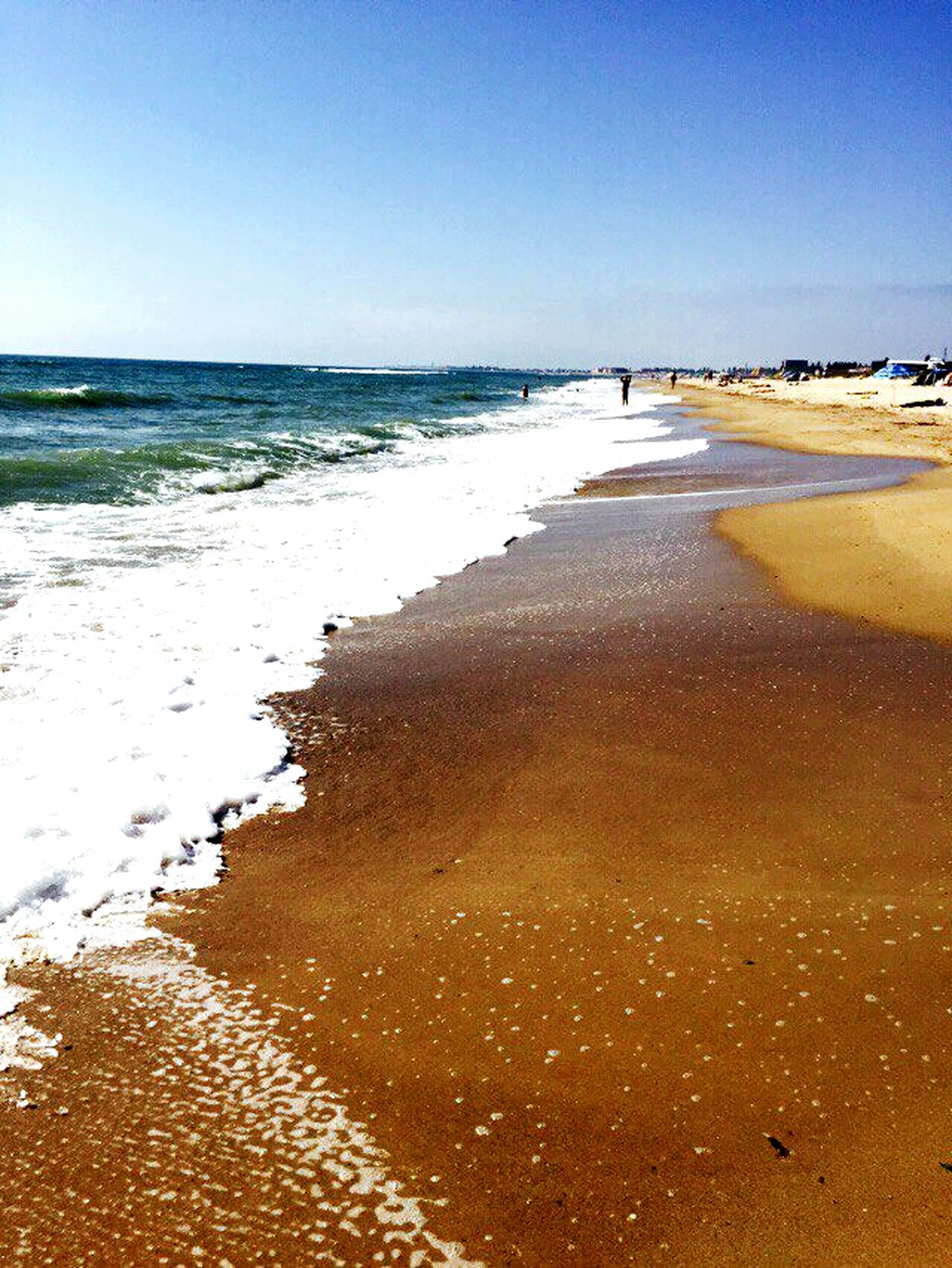 sea, beach, water, clear sky, horizon over water, sand, shore, tranquility, tranquil scene, scenics, wave, beauty in nature, nature, coastline, idyllic, blue, outdoors, sky, vacations, travel destinations, no people, ocean, day, tourism, remote, the way forward, calm, non-urban scene