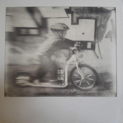 Benny goes tu future :-) Enjoying Life Polaroid Art Polaroid Spectra Kickbike Scooter Footbike Bw Kid Impossible Project First Eyeem Photo