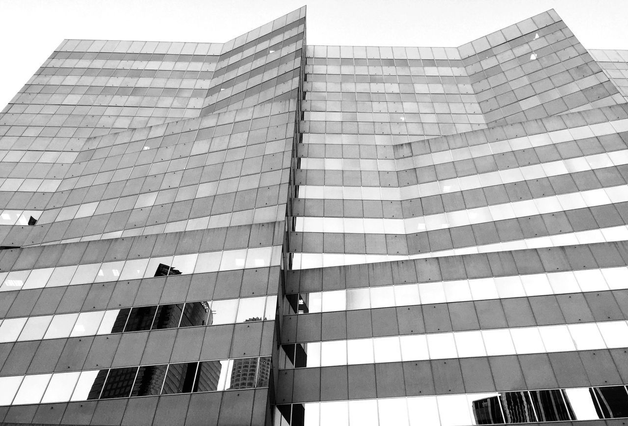 architecture, building exterior, skyscraper, modern, built structure, tall, low angle view, city, outdoors, corporate business, day, growth, no people, sky