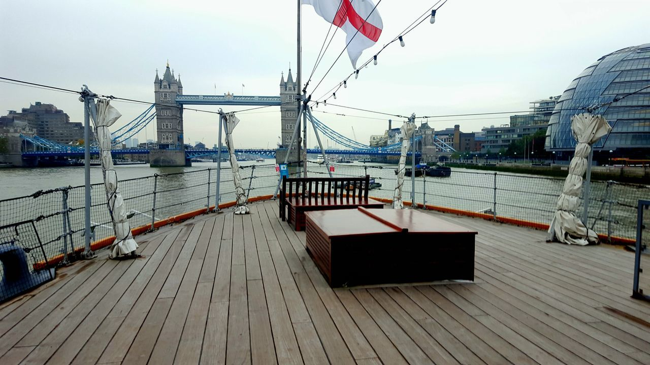 Perfect place for a morning coffee! HMS Belfast London London Lifestyle Central London, UK Landscape Flag Water Patriotism Bridge - Man Made Structure Travel Destinations Connection Outdoors Built Structure Sky Suspension Bridge No People Architecture Day First Eyeem Photo