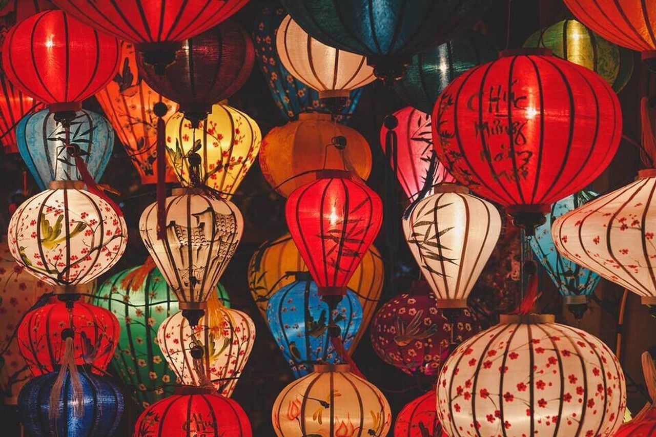 hanging, lighting equipment, lantern, illuminated, cultures, celebration, variation, no people, for sale, large group of objects, choice, multi colored, retail, low angle view, full frame, market, night, indoors