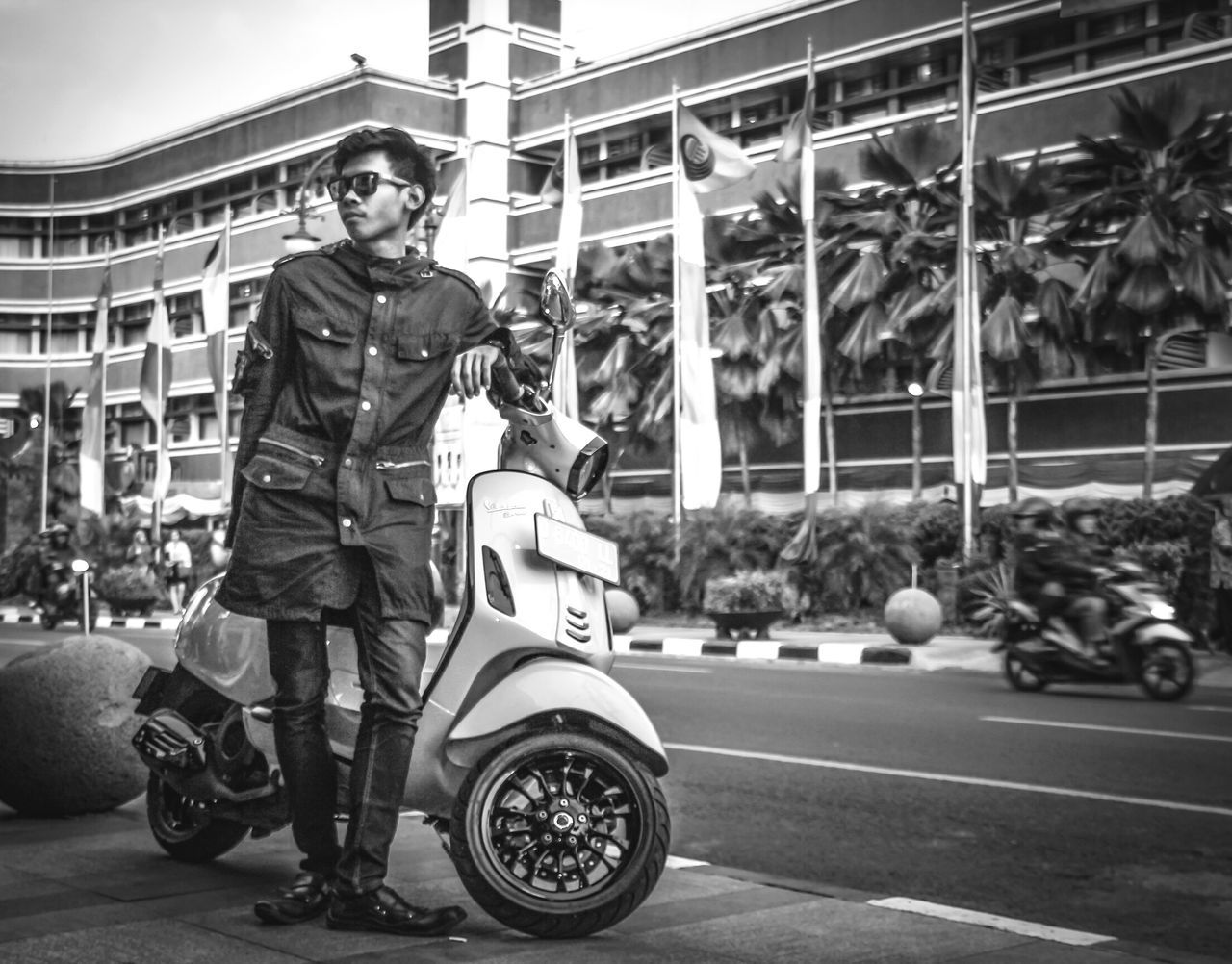 real people, motorcycle, one person, transportation, land vehicle, outdoors, full length, lifestyles, day, helmet, standing, men, building exterior, architecture, young adult, biker, sky, people