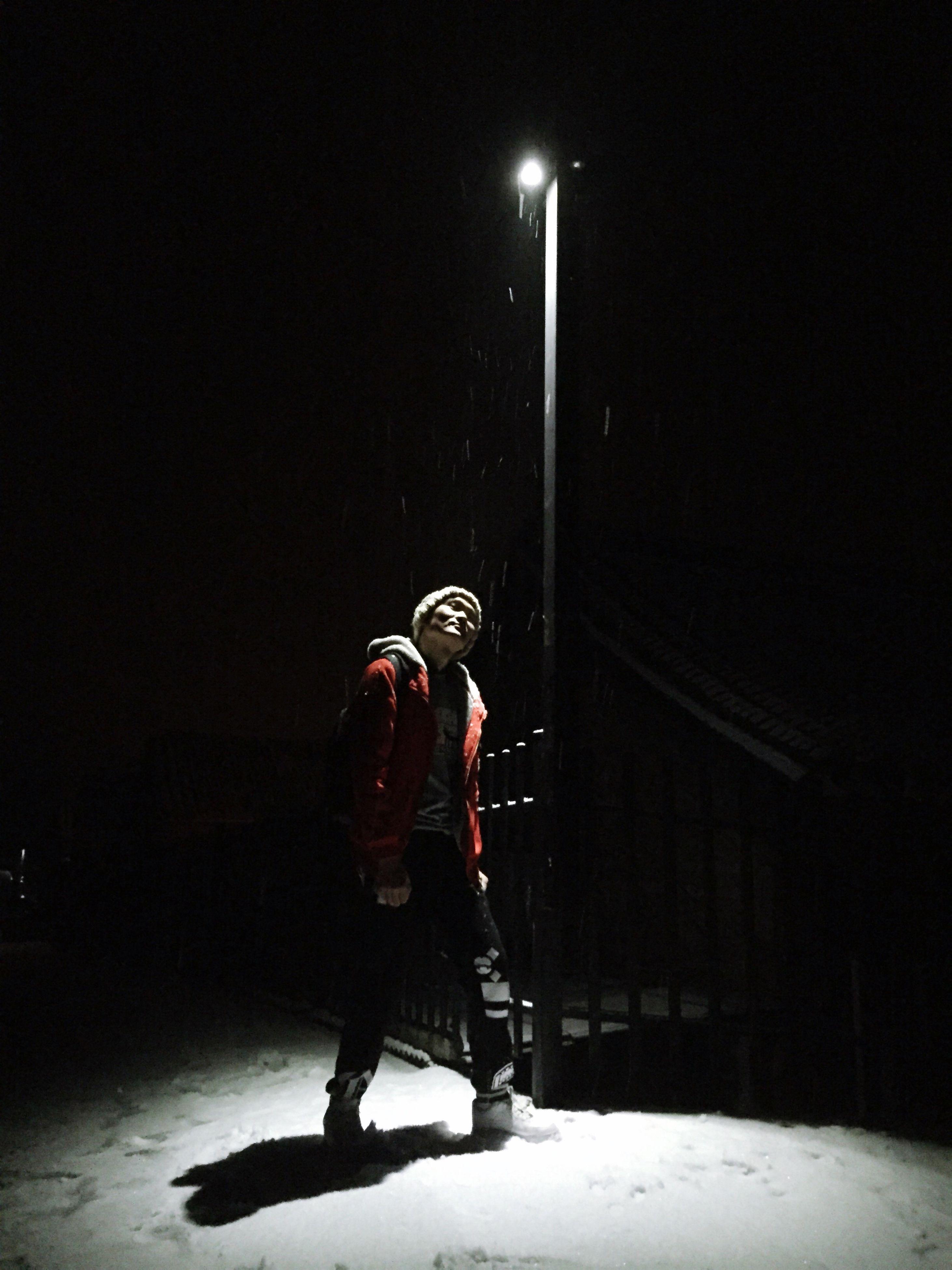 night, illuminated, full length, street light, lifestyles, leisure activity, lighting equipment, casual clothing, outdoors, season, dark, weather, sky, the way forward