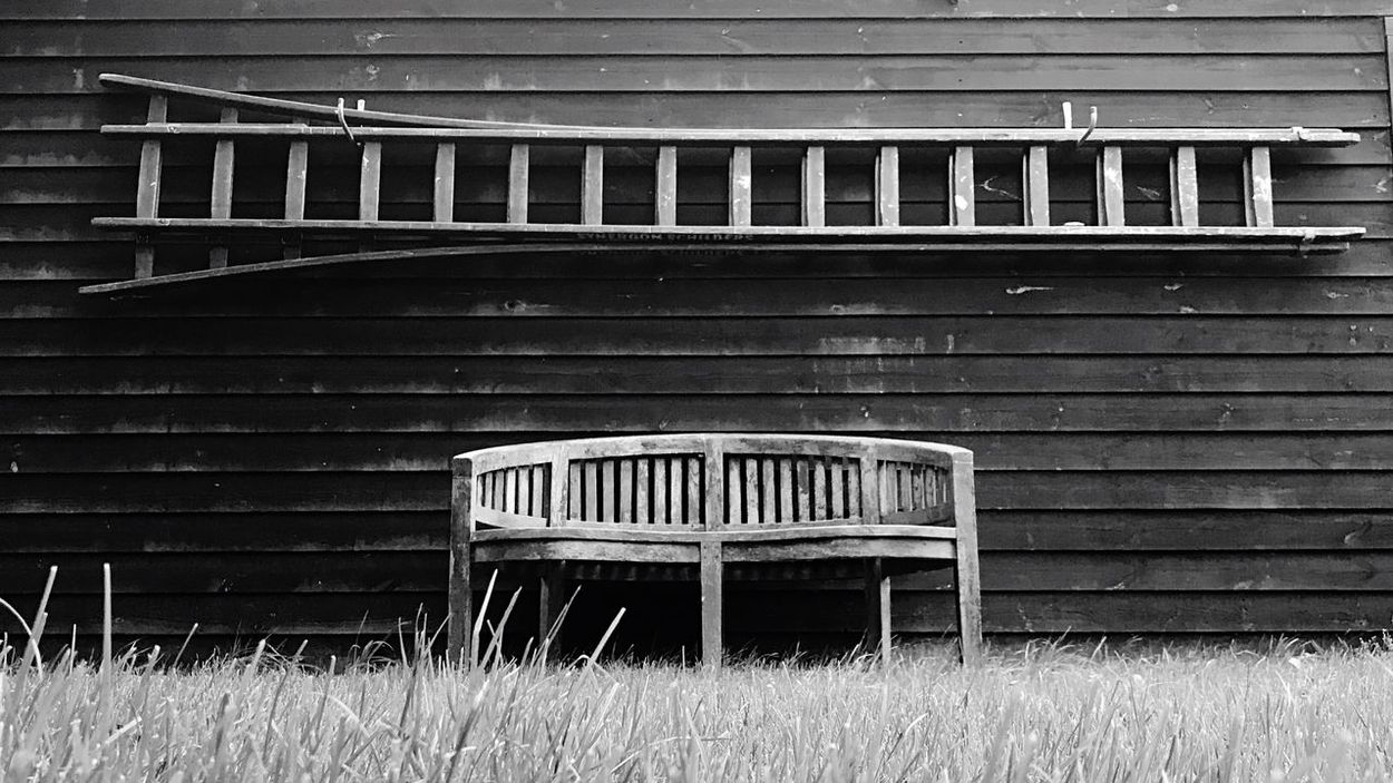 EyeEmNewHere Nature Wood - Material Grass Ladder To Nowhere Ladder On The Wall Blackandwhite Black Wall Emptychairsproject Empty Chair Empty Chair Project EmptyChairSeries Black And White Friday