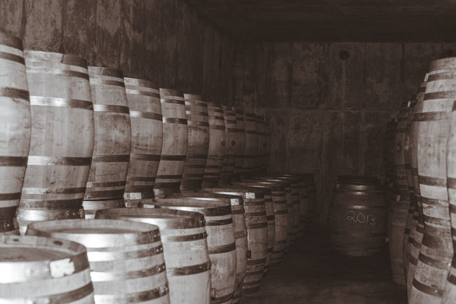 Ages  Aging Barrel Barrels Black And White Cellar Cellar Room Day Gray Grey In A Row Indoors  Monochrome No People Oahu Production Wine Wine Cask Wine Making Wine Moments Winery Wood