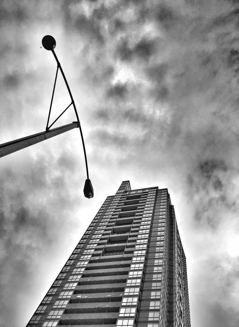 low angle view, architecture, built structure, sky, building exterior, skyscraper, cloud - sky, modern, outdoors, day, no people, city