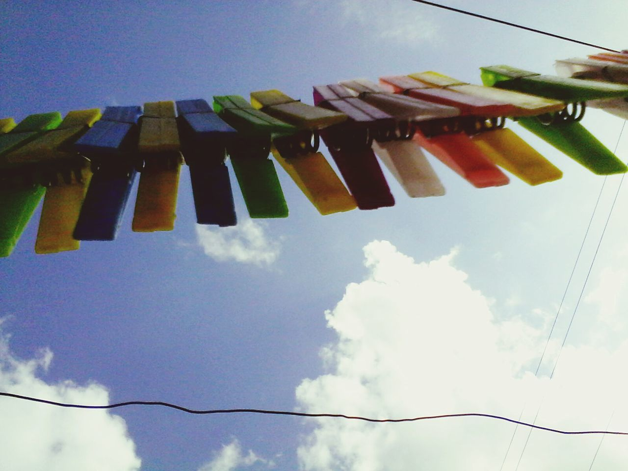 hanging, sky, low angle view, variation, no people, multi colored, large group of objects, outdoors, cloud - sky, day, close-up