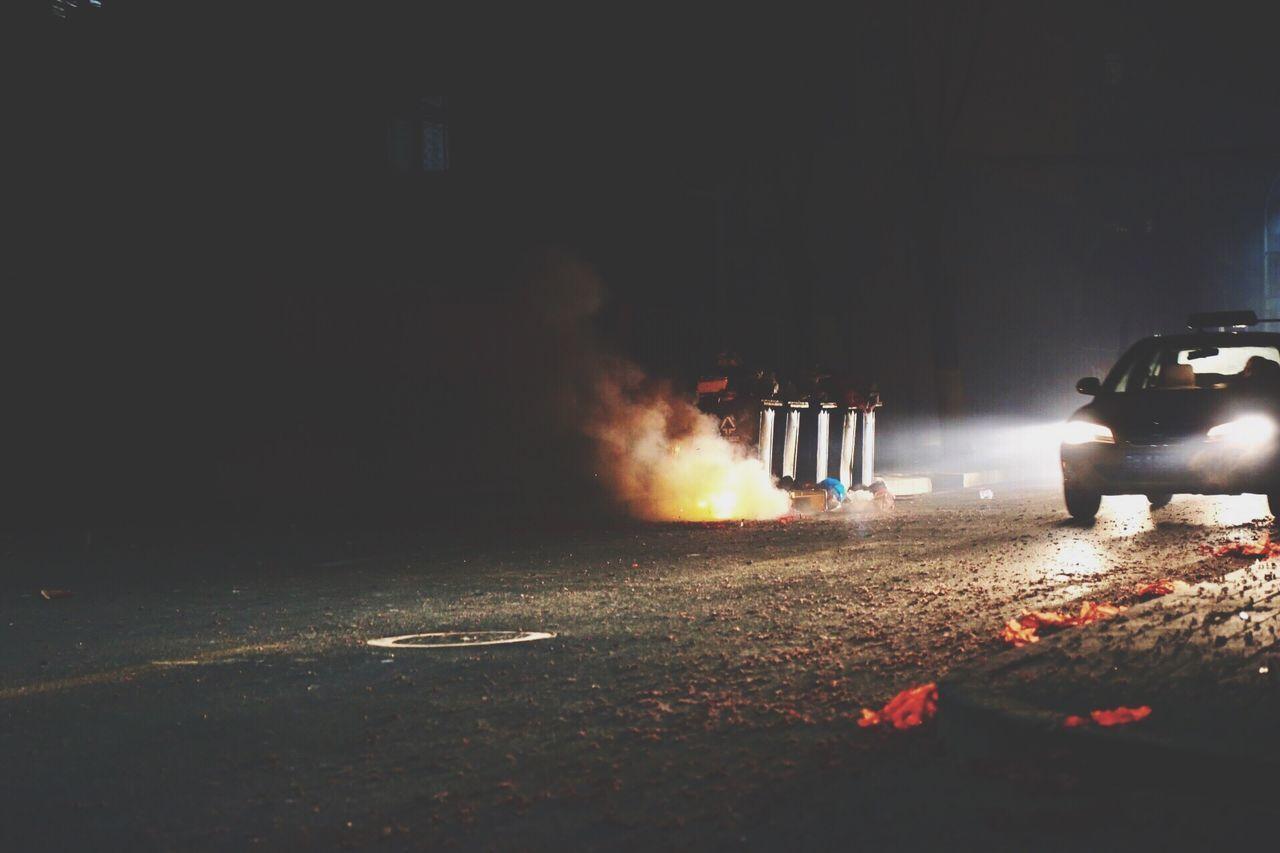 night, smoke - physical structure, illuminated, outdoors, land vehicle, no people