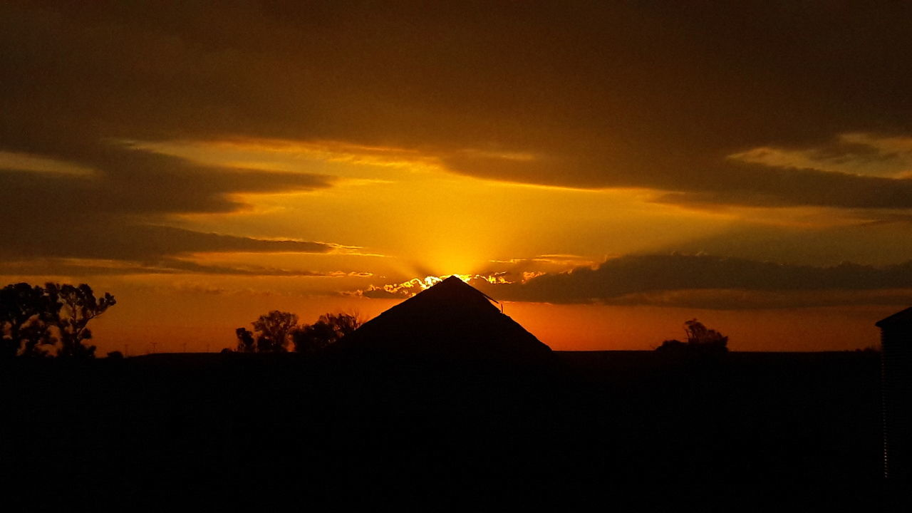 South dakota farm pyramid Silhouette Sunset Scenics Tranquil Scene Sky Tranquility Landscape Beauty In Nature Cloud - Sky Orange Color Nature Idyllic Mountain Majestic Non-urban Scene Cloud Dramatic Sky Outdoors Rural Scene Dark Farm Life Barn Barnlife Sun