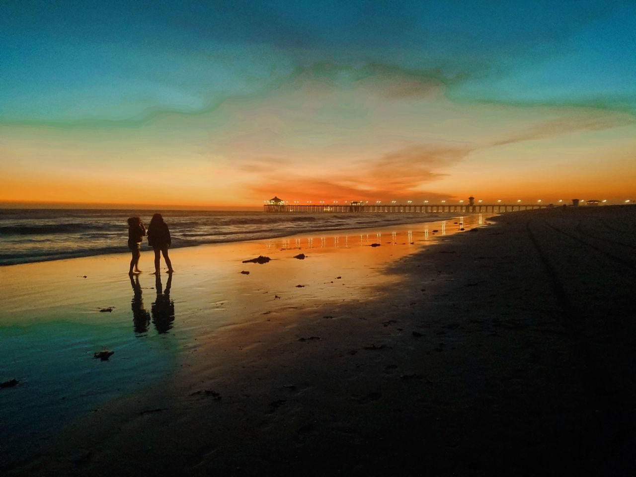 beach, sunset, sea, sky, silhouette, sand, nature, water, real people, full length, walking, vacations, beauty in nature, scenics, tranquil scene, leisure activity, outdoors, two people, cloud - sky, tranquility, horizon over water, men, standing, lifestyles, togetherness, women, wave, day, adult, people