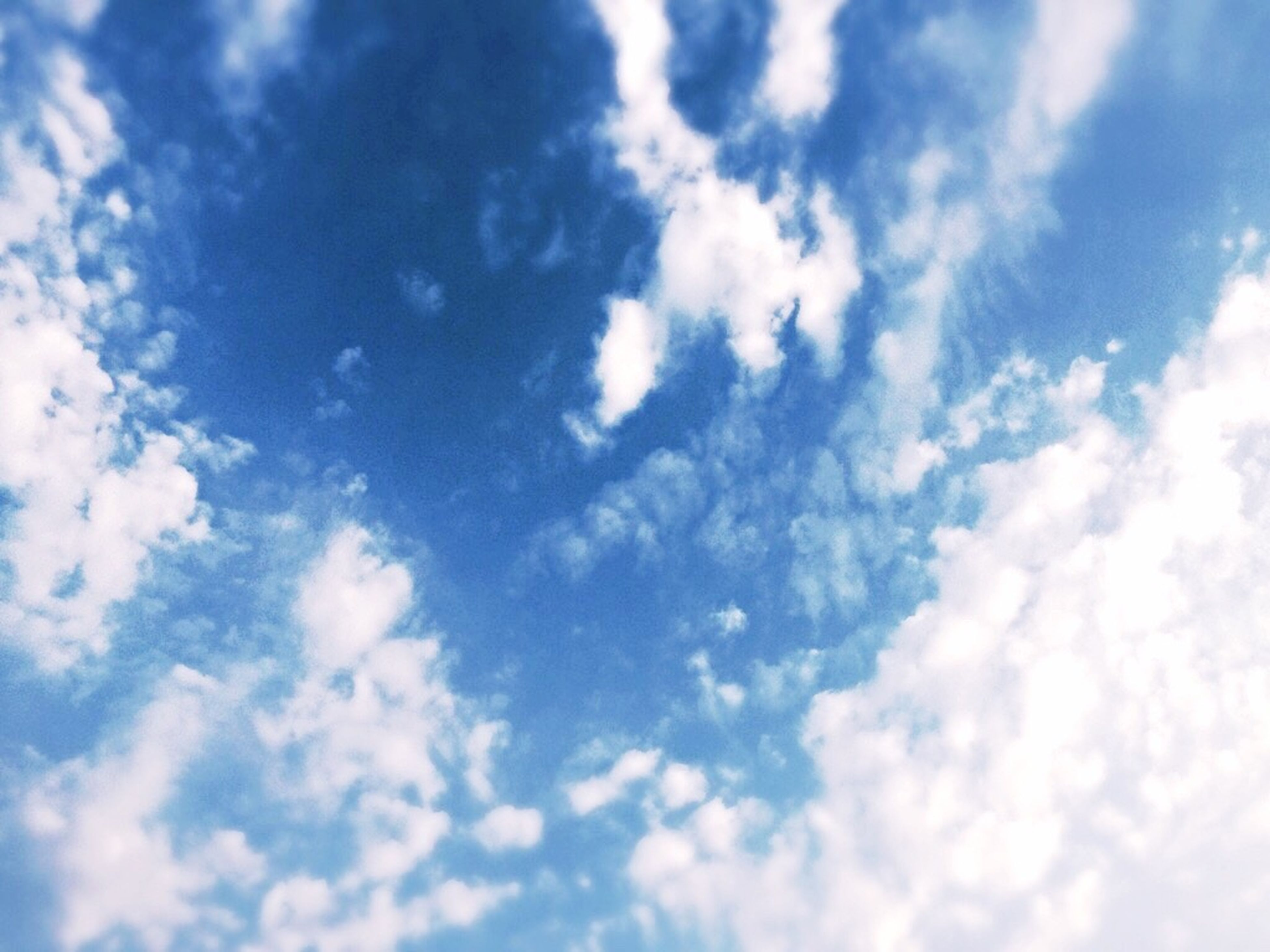 beauty in nature, low angle view, tranquility, scenics, sky, blue, tranquil scene, majestic, cloud - sky, nature, backgrounds, white, cloud, cloudscape, day, full frame, sky only, idyllic, heaven, meteorology, outdoors, fluffy, softness, ethereal, dreamlike, cloudy, no people, cumulus cloud