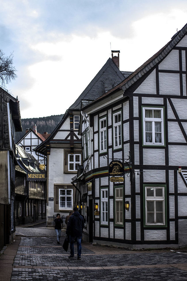 Architecture Building Exterior Built Structure City City Life Cloud Cloud - Sky Day Footpath Germany Goslar Goslar Germany Men Old Town Person Residential Building Residential District Residential Structure Sky Street The Way Forward Tourism Walking