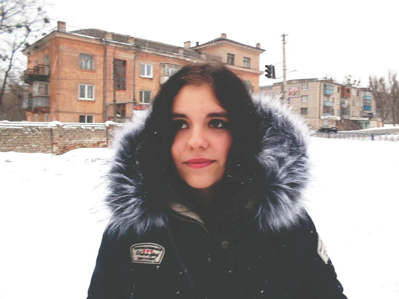 Winter Snow Cold Temperature Looking At Camera Warm Clothing Portrait Weather Snowing Outdoors One Person Young Adult Building Exterior Frozen People Overcoat Adults Only Young Women City One Woman Only Day