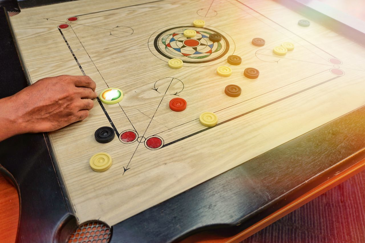Human Body Part Human Hand One Person One Man Only Only Men People Indoors  Men Adults Only Adult Close-up Day Game Play Playing Playing Games Carom Carrom Carrom Board Carroms Carromboard Fun Holiday Practicing Training