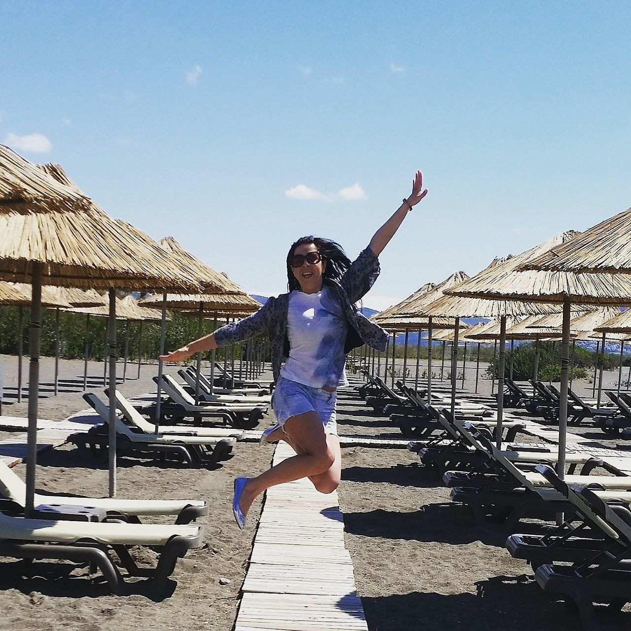 Life is a beach! One Person Happiness Sky Motion Beach Adventure Holiday Trip joy jumping life Blue Sky