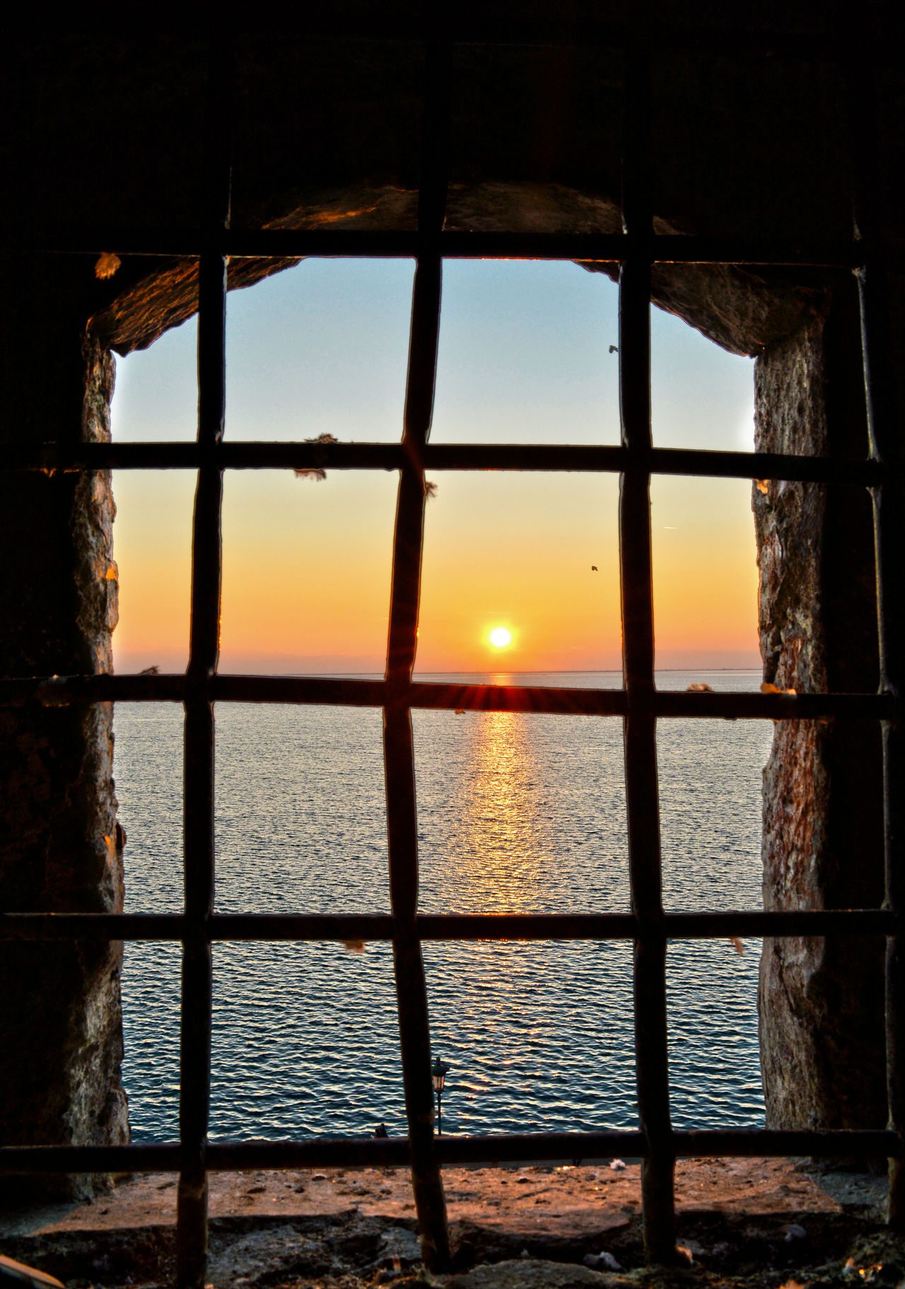 Behind Bars Architecture Beach Beauty In Nature Day Greece Horizon Over Water Insideout Museum Nature No People Old Buildings Old Prison Prison Sea Sky Sun Sunlight Sunset Thessaloniki Water White Tower White Tower Of Thessaloniki Window