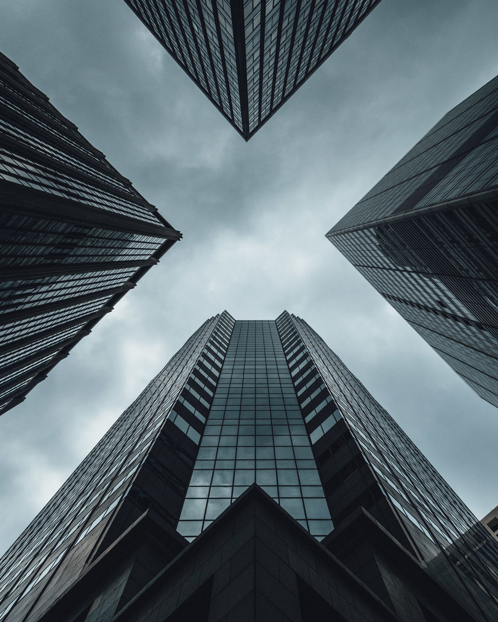 architecture, built structure, building exterior, low angle view, skyscraper, sky, modern, tall - high, directly below, tower, city, day, tall, outdoors, no people, corporate business, cloud - sky, office park