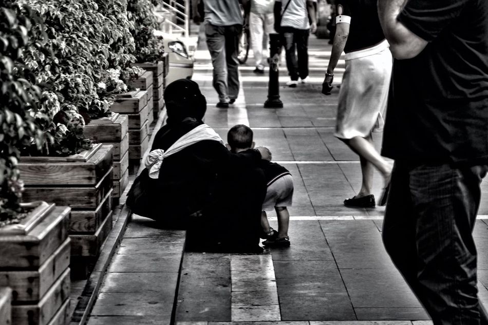 EyeEm Best Shots EyemBestEdits Blackandwhite EyeEm Real People Togetherness Walking Men Lifestyles Sidewalk Women Sitting Standing Outdoors City Day Adult People (null)Black And White Street Bnw Streetphotography Portrait Streetphoto_bw