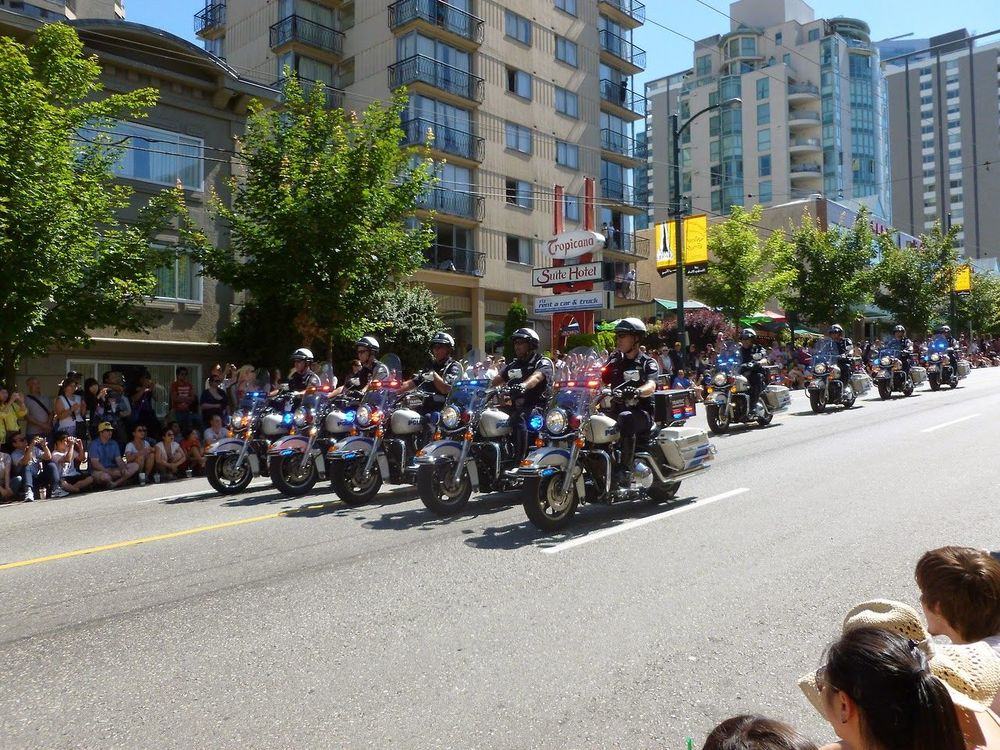 Police giving a show on their Motorbikes before the 2012 Vancouver Pride Parade. Parade Building Exterior Street Celebration City Road Outdoors Large Group Of People Day Real People People Canada Beautifully Organized Carnival Crowds And Details