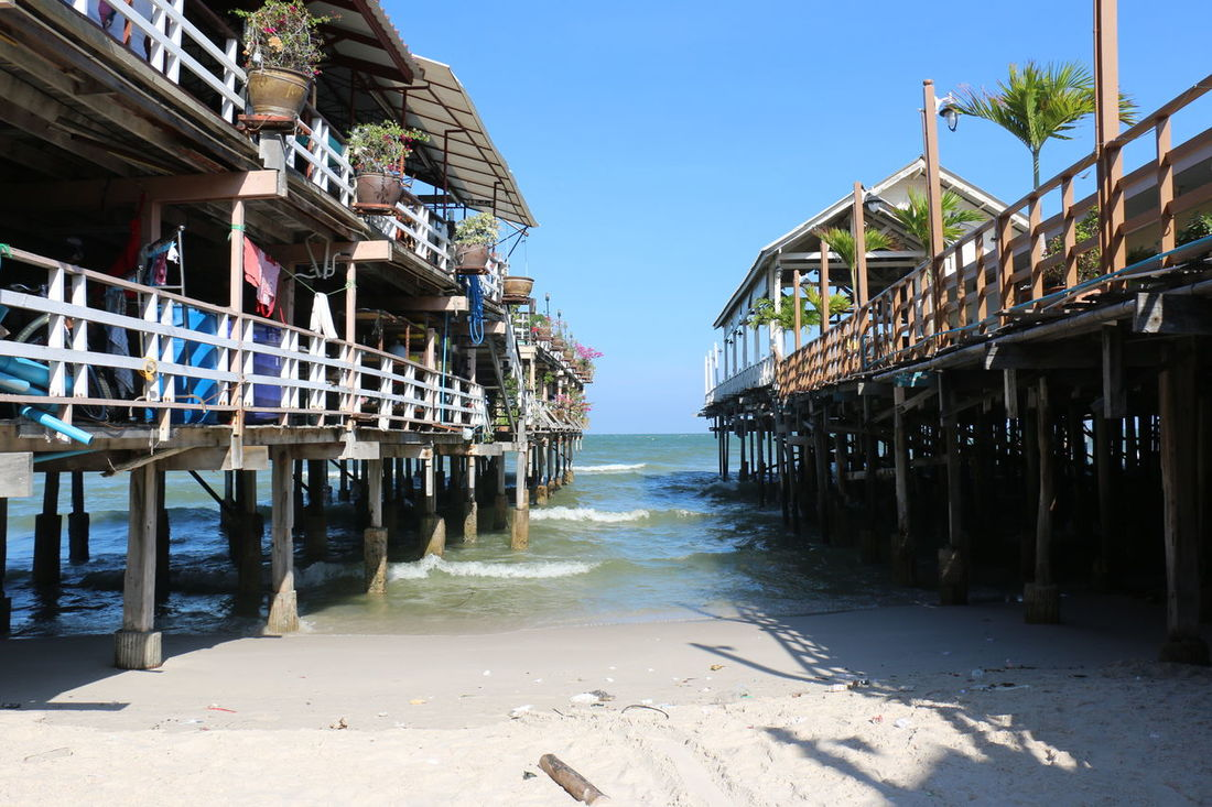 Sea Beach Water Travel Destinations Outdoors Stilt House Day Built Structure Sky Sand Building Exterior Architecture No People Daylight HuaHin Sea@Thailand Huahin Thailand Sunlight Holiday Green Pattern Let's Go. Together. Waters Blueskies Clearsky Huahinbeach