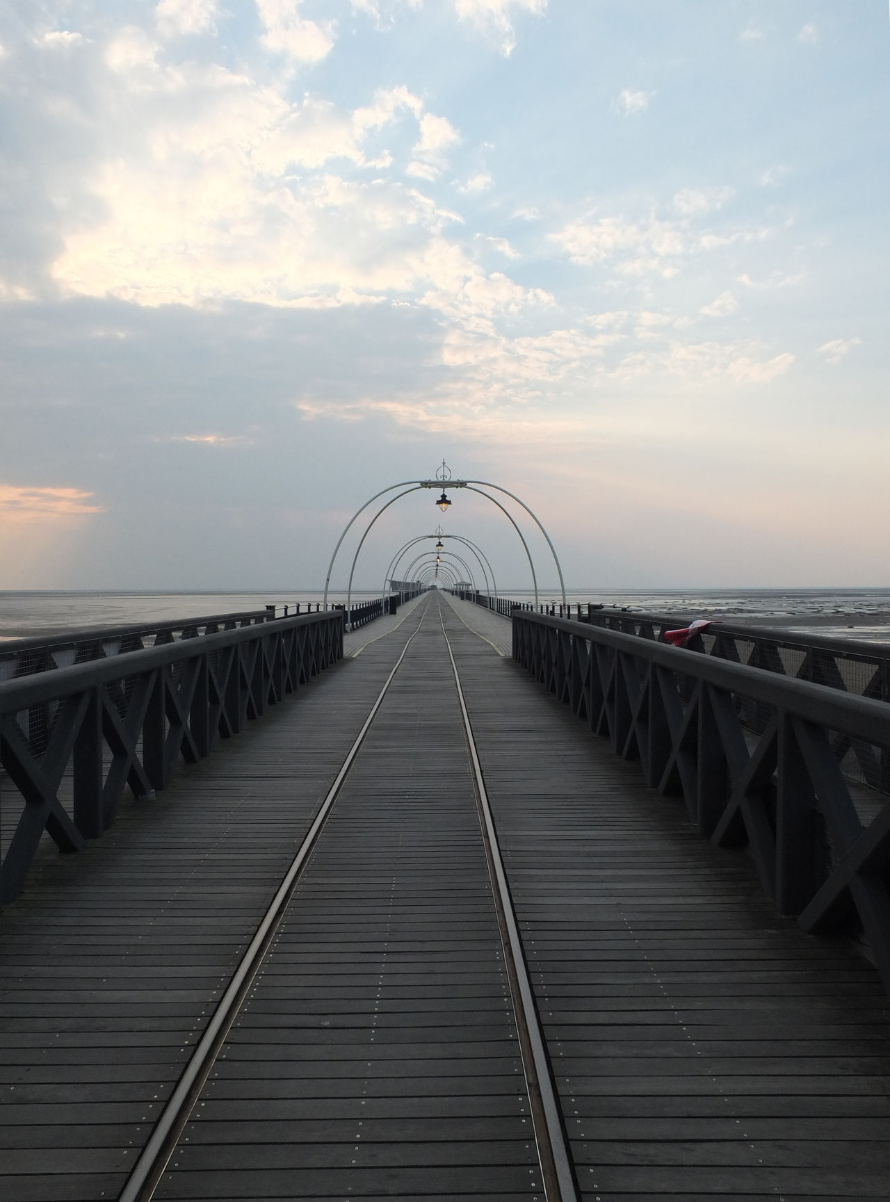 southport pier in lancashire Architecture Beauty In Nature Bridge - Man Made Structure Built Structure Cloud - Sky Connection Day Diminishing Perspective Horizon Over Water Industry Nature No People Outdoors Pink Color Railing Scenics Sea Sky Southport Southport Pier Sunset The Way Forward Water