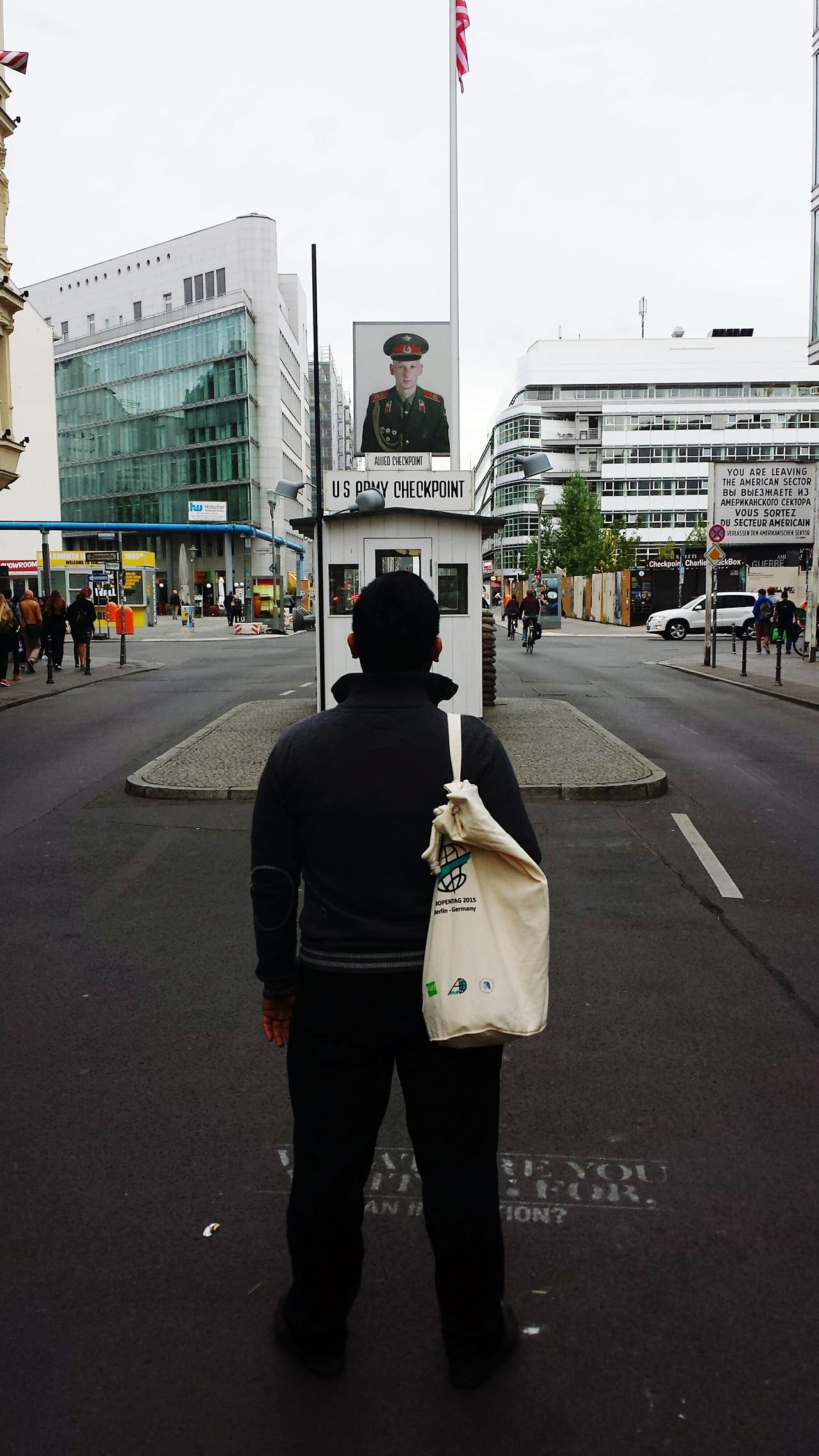 Capture Berlin Rear View One Man Only Only Men One Person Full Length Adults Only City One Young Man Only Patriotism Architecture Real People Outdoors People Adult Sky Young Adult Day Checkpointcharlie Check Point Charlie Berlin Street Photography Berlin Life Berlin, Germany  Berlin Berlin History