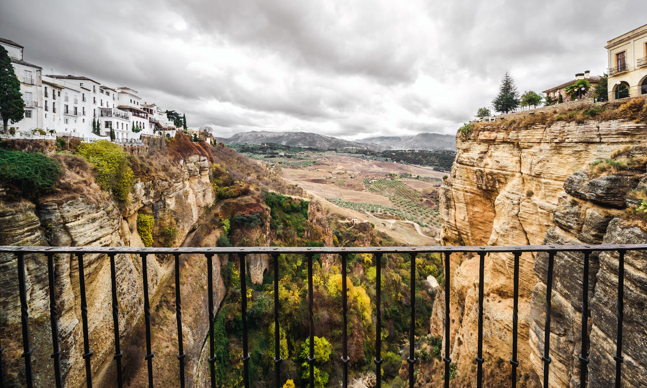 Picturesque view of Ronda city. Province of Malaga, Andalusia, Spain Ancient Architecture Andalusia Cliff Cloud Costa Del Sol Famous Place Heritage Hilltop History Houses Landmark Landscape Malaga Mountain Nature Old Town Outdoors Picturesque Village Rocky Mountains Ronda Spain SPAIN Tourist Attraction  Town Travel Destinations Village