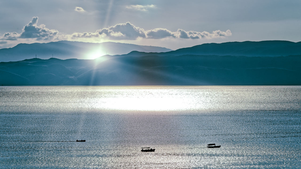 Reflecting Albania Beauty In Nature Cloud - Sky EyeEmNewHere Idyllic Landscape Mountain Outdoors Reflection Scenics Sky Sun Sunbeam Sunlight Tranquil Scene Tranquility Water