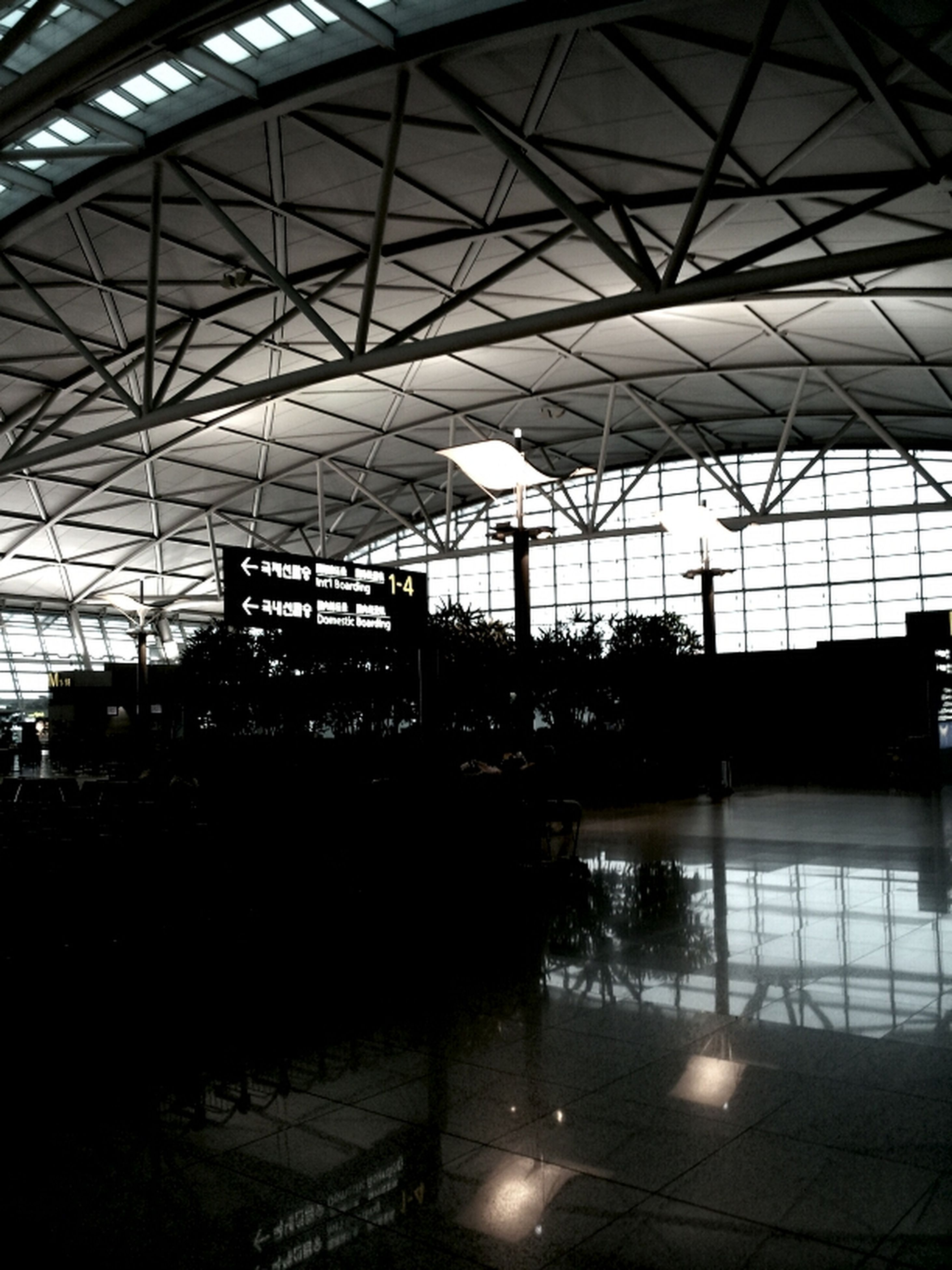 indoors, ceiling, glass - material, built structure, architecture, window, transparent, reflection, silhouette, interior, illuminated, glass, sunlight, modern, no people, railroad station, skylight, flooring, transportation, day
