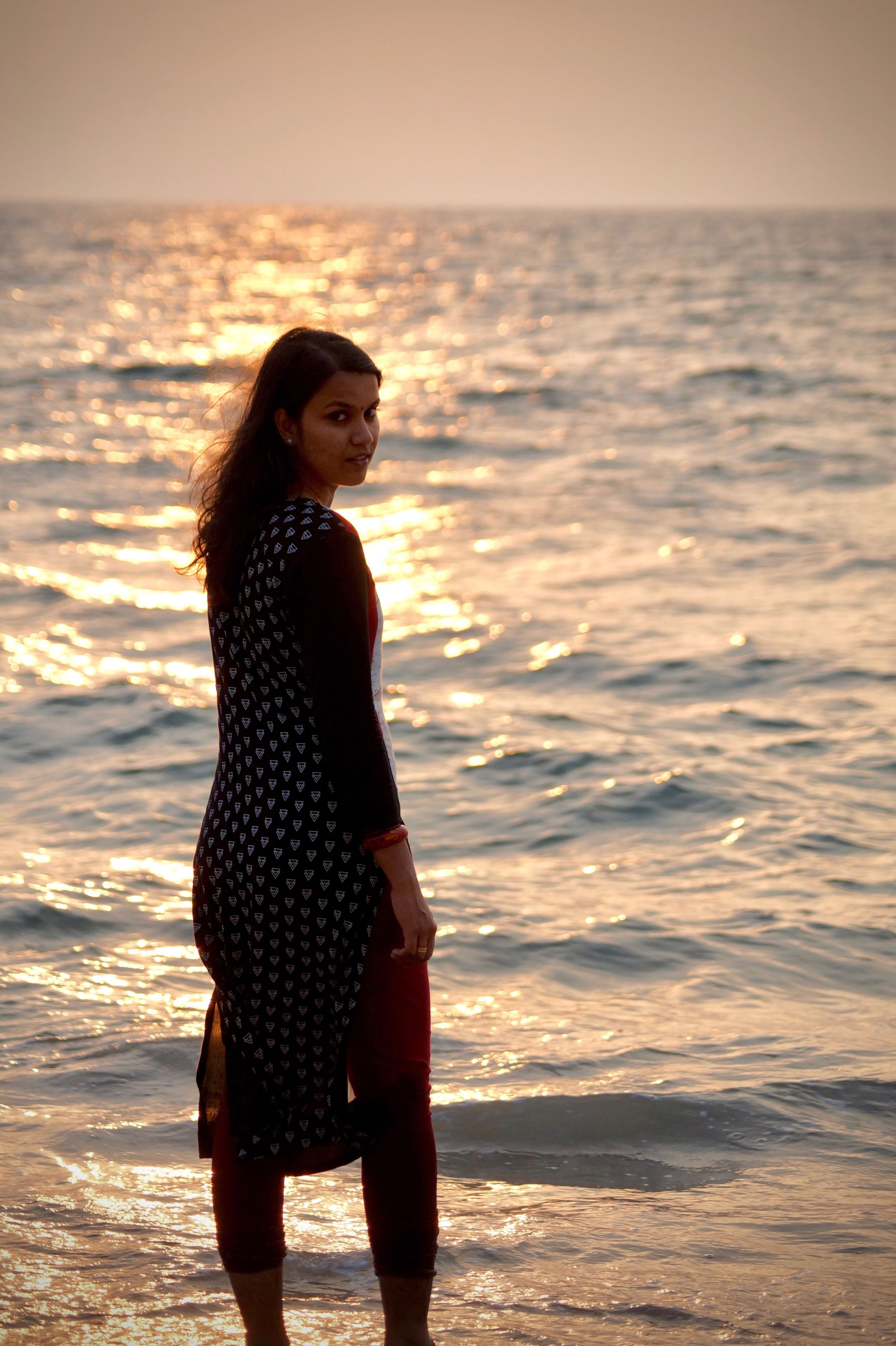 sea, sunset, beach, standing, one woman only, only women, one person, portrait, adults only, adult, young adult, nature, beautiful people, beauty in nature, vacations, outdoors, beauty, sky, water, women, people, one young woman only, beautiful woman, wave, day
