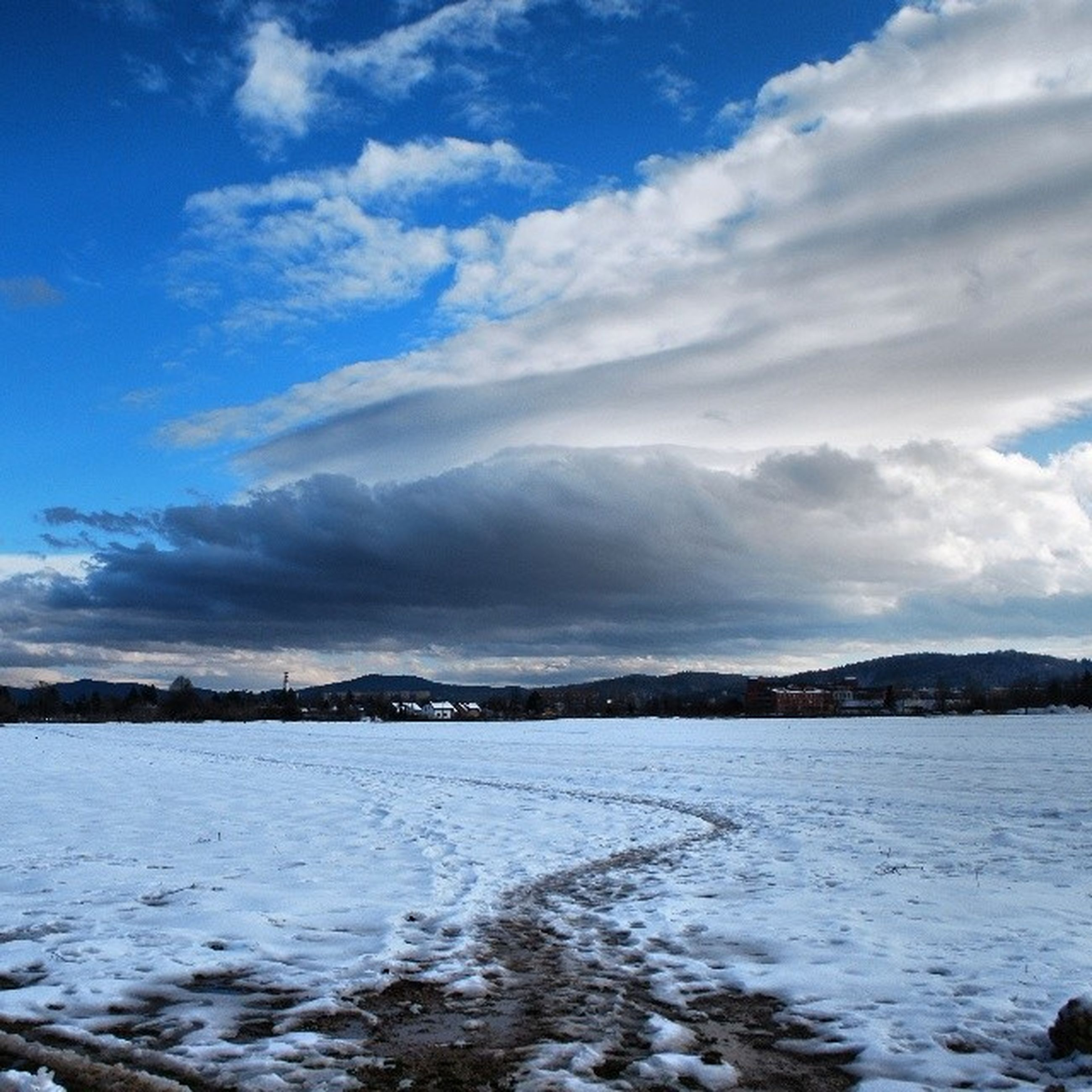water, tranquil scene, sky, tranquility, scenics, beauty in nature, nature, cloud - sky, cloud, sea, lake, blue, waterfront, winter, snow, cold temperature, idyllic, outdoors, non-urban scene, landscape