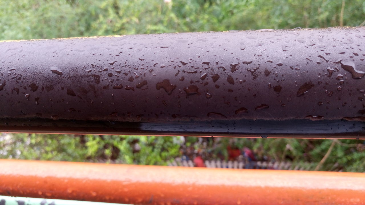 drop, day, water, wet, close-up, outdoors, no people, land vehicle, raindrop, focus on foreground