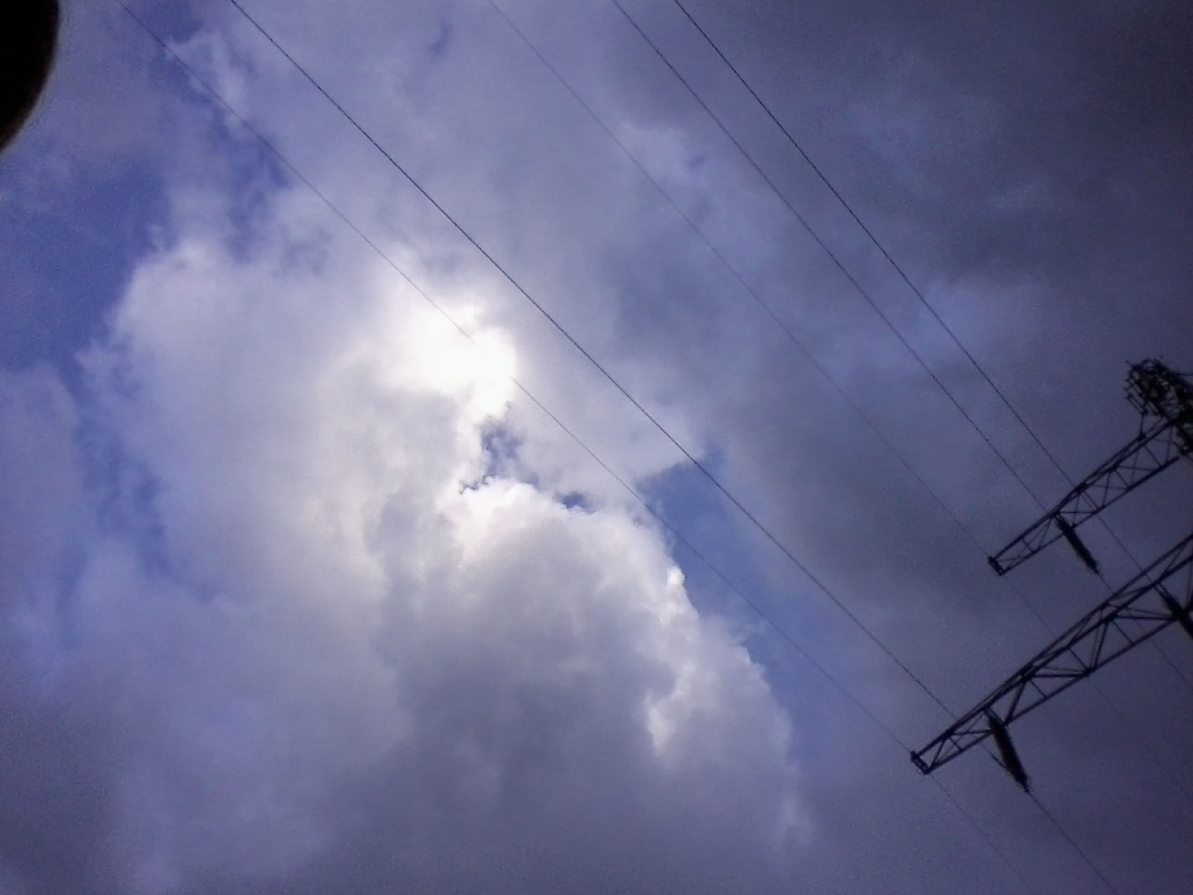 power line, low angle view, electricity, power supply, electricity pylon, cable, sky, connection, cloud - sky, fuel and power generation, technology, power cable, cloudy, cloud, silhouette, blue, nature, outdoors, no people, beauty in nature