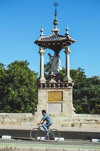 Riding along Pont dal Real València SPAIN riding bike Biker Holy Sculpture Bycicle Earphones Streetphotography Rider Sunny Day Day Pleasure Street Bridge Road Traveling Ride Riding Riding Bike Lonely Bike Lane Enjoying Life Fujifilm X-E2