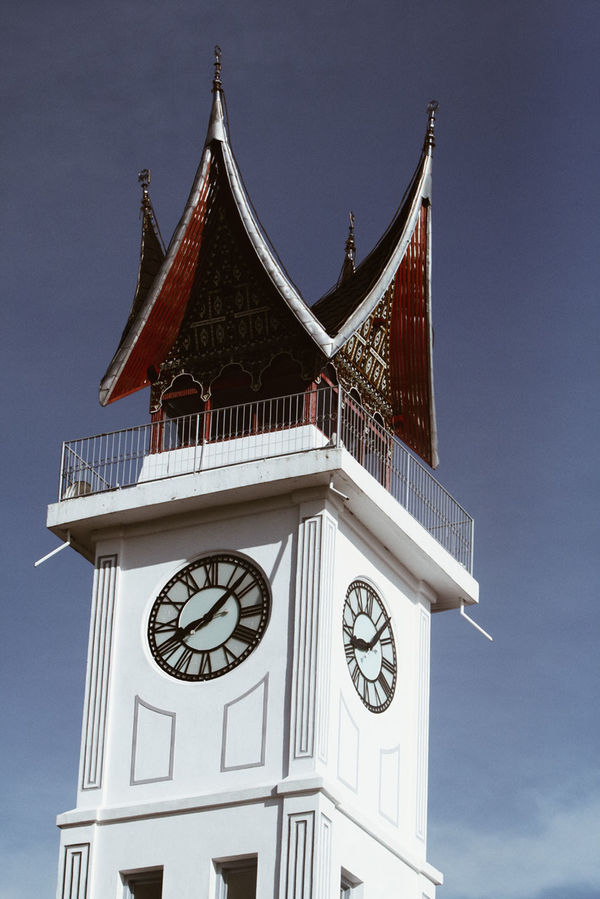 "Jam Gadang (literally ""Big Clock"") is a clocktower and major landmark of the city of Bukittinggi, West Sumatra, Indonesia. It is located in the centre of the city, near the main market, Pasar Atas, and is a tourist attraction. This clocktower has large clocks on each side and was given the name ""Jam Gadang"" (English: big clock). Big Clock Bukit Tinggi City Landmark City Landscape Cityscape Clock Clock Tower Gadang Indonenesia Landmark SumateraBarat Tourism Urbanphotography"