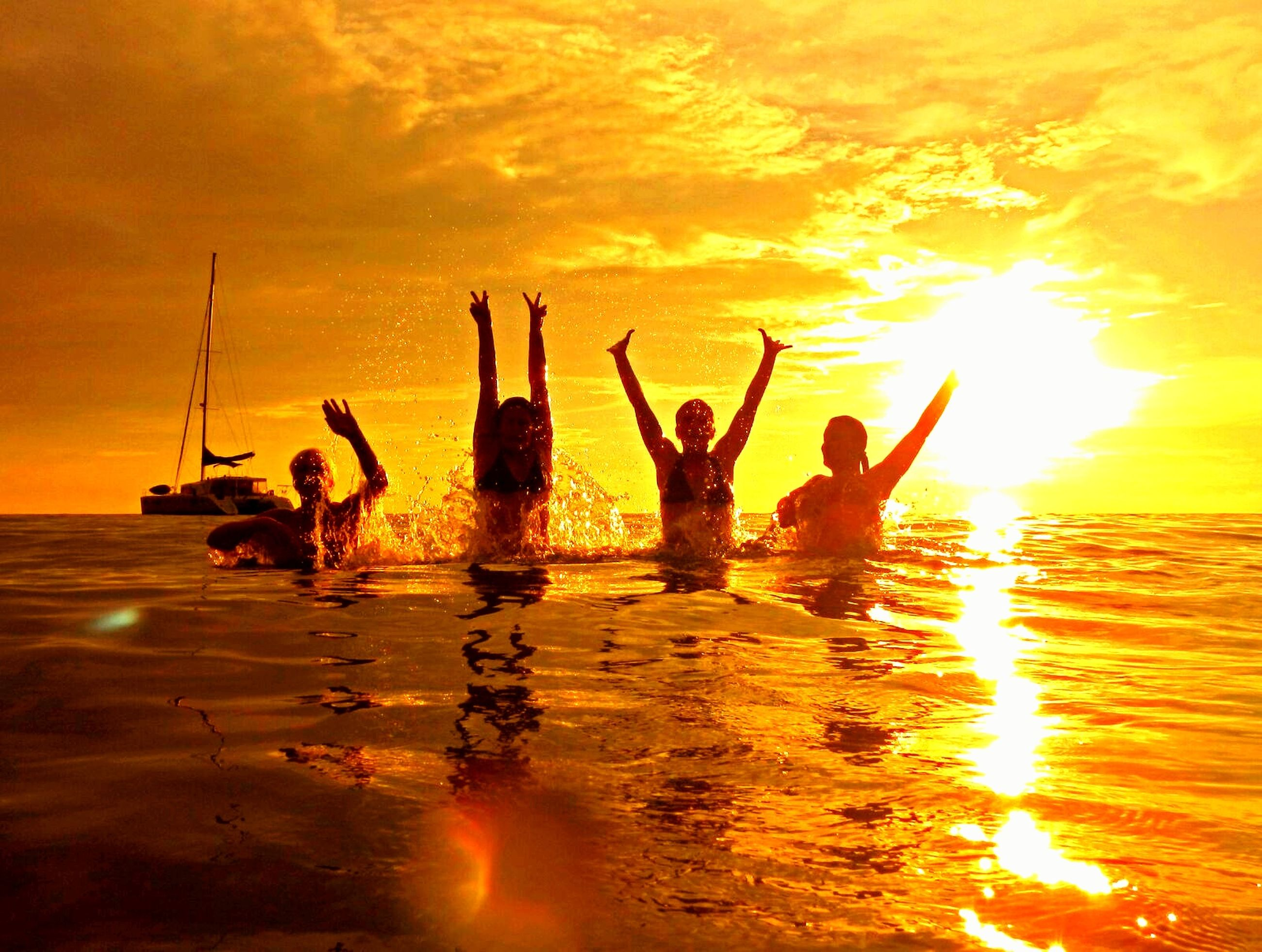 sunset, friendship, fun, water, summer, happiness, beach, dusk, sea, vacations, party - social event, arms raised, silhouette, dramatic sky, group of people, women, sun, men, outdoors, people, jumping, teamwork, togetherness, human arm, adult, sky, human body part, nature, human hand