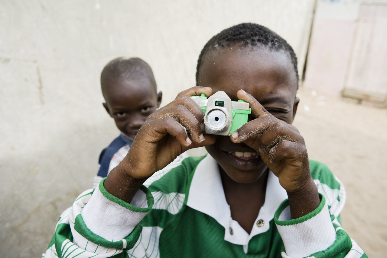 Kids playing with a toy camera in the narrow streets of N'gor, in Senegal. Senegal Capture The Moment Traveling Africa Taking Photos Cheese! Hello World EyeEm Best Shots Eye4photography  Hello World