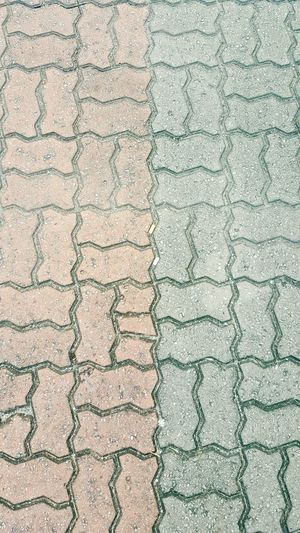 Backgrounds Full Frame Pattern Textured  Day No People Outdoors Close-up Interlocking Brick Interlocking Blocks Interlocking Pavers Floor Finishes Coloured Bricks Floor Materials External Floor Material
