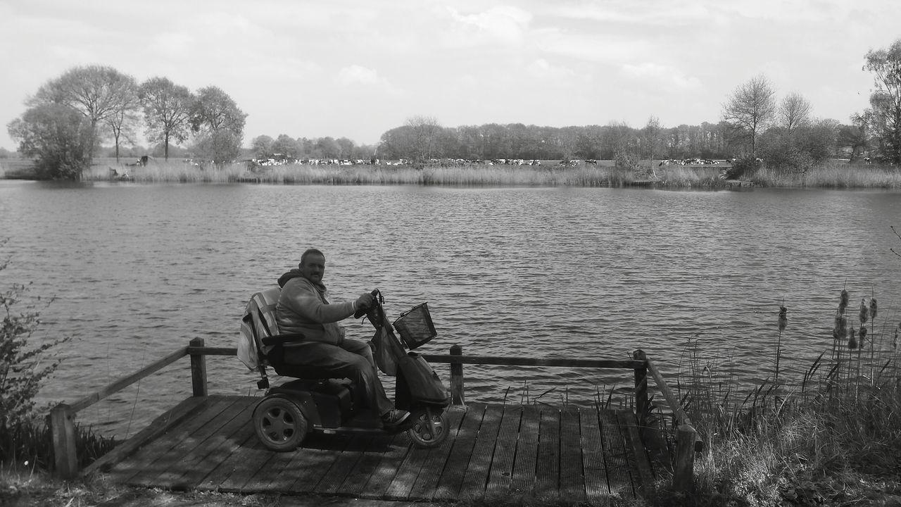 Man At Lake Against Sky