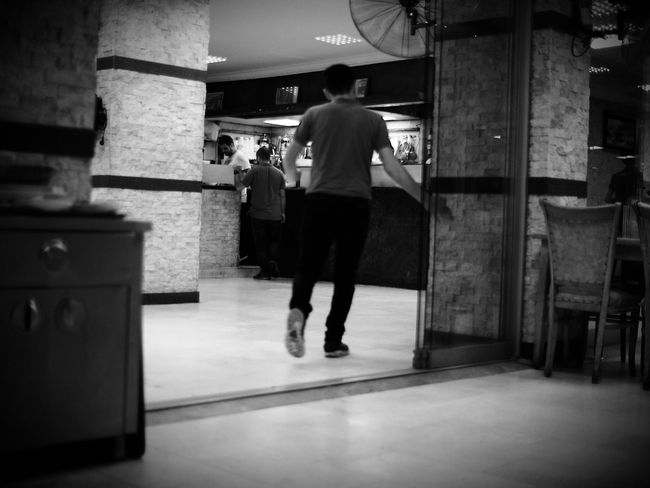 Not sure that this is a great photo but I like it 😬😂 Rear View Full Length Walking Architecture Built Structure Person Vignette Casual Clothing Day City Life Restaurant Restaurant Scene Izmir ❤ Izmir/ Bornova Izmir Turkey Shallow Depth Of Field Black & White Blackandwhite Monochrome Black And White