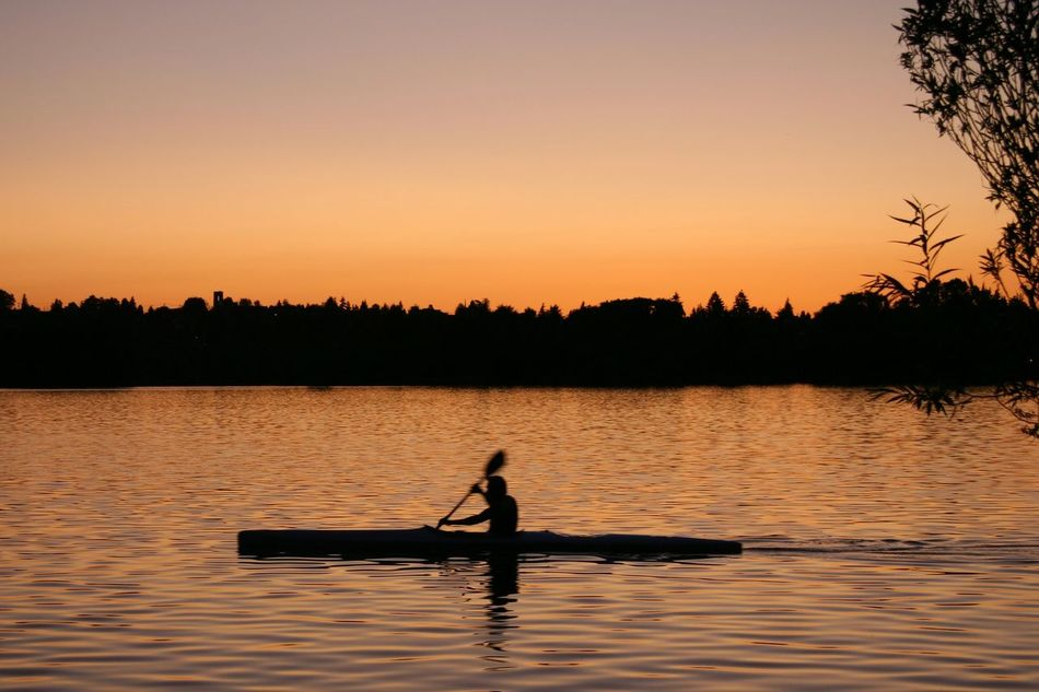 Sunset Lake Reflection Travel Silhouette Tranquility Travel Destinations Outdoors Nautical Vessel Journey One Person Nature Vacations Kayak Full Length Beauty In Nature Water Tree Scenics Outdoor Pursuit