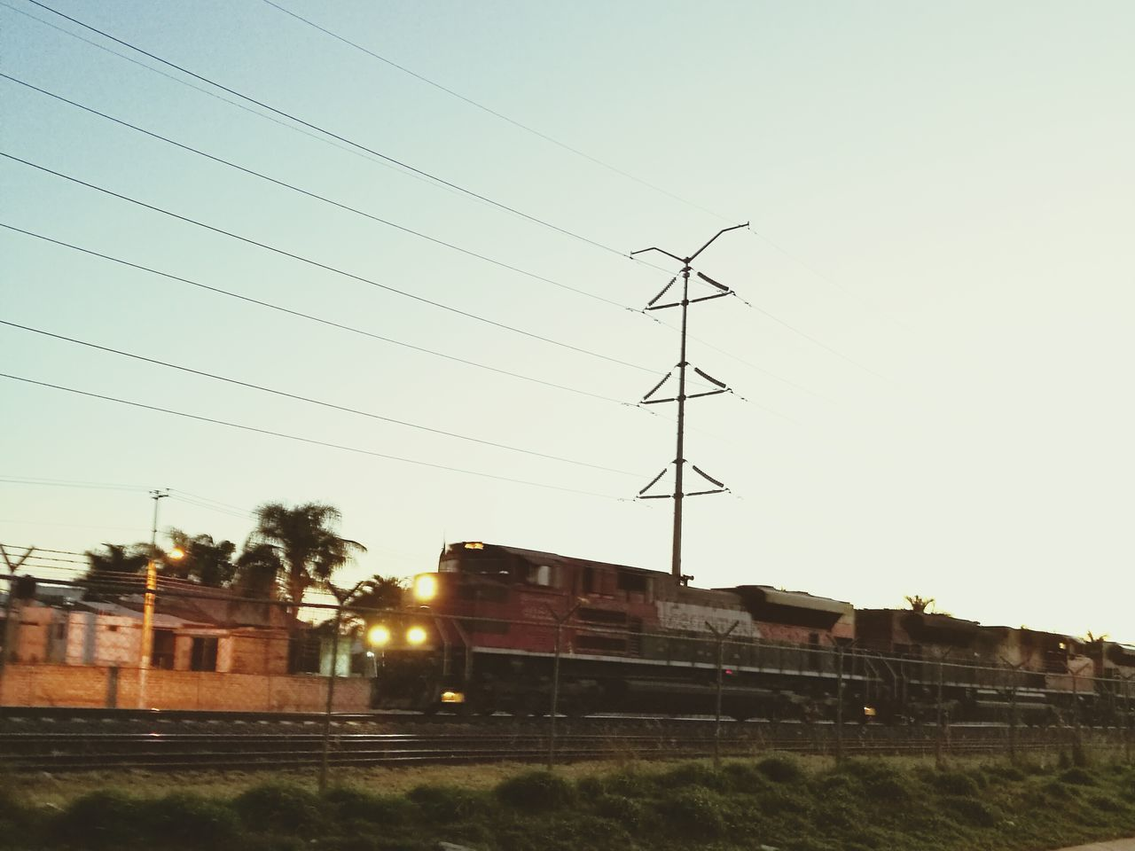 Train Train Tracks Sky Electric Tower  Sunset House Building Exterior Built Structure No People Outdoors Tree Architecture Transportation Road Nature Day